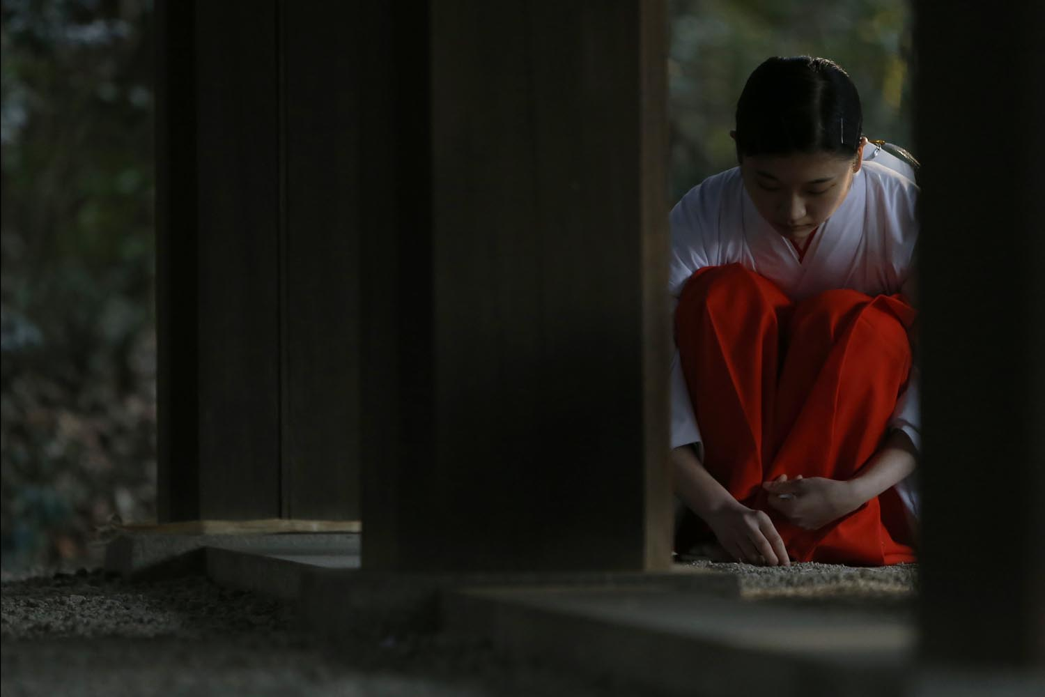 Dec. 31, 2013. A shrine attendant cleans up after a ritual to bid farewell to 2013 and prepare for the new year at the Meiji Shrine in Tokyo.