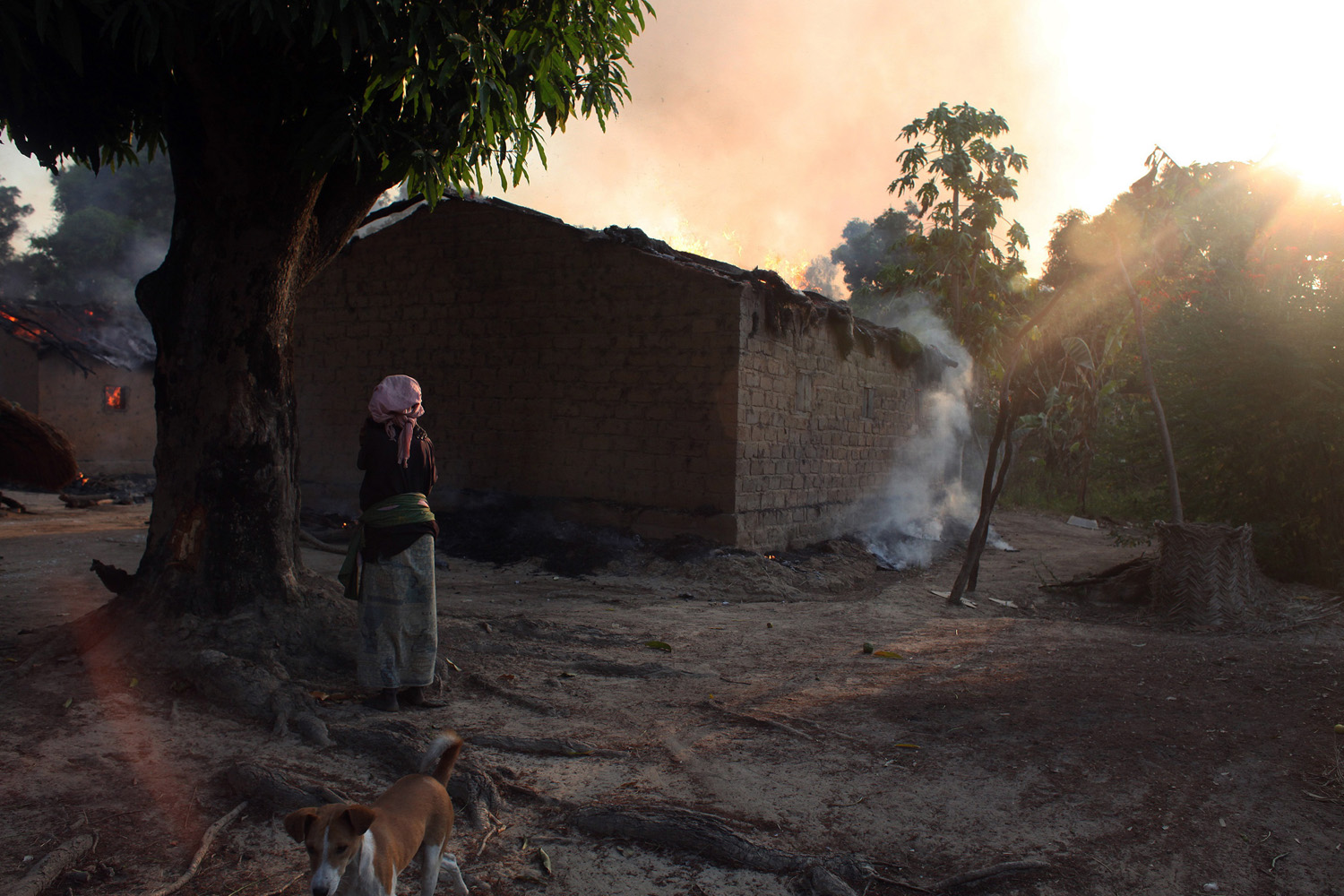 Jan. 3, 2013. A woman looks at burning houses in Bossangoa, north of the Central African Republic's capital Bangu.