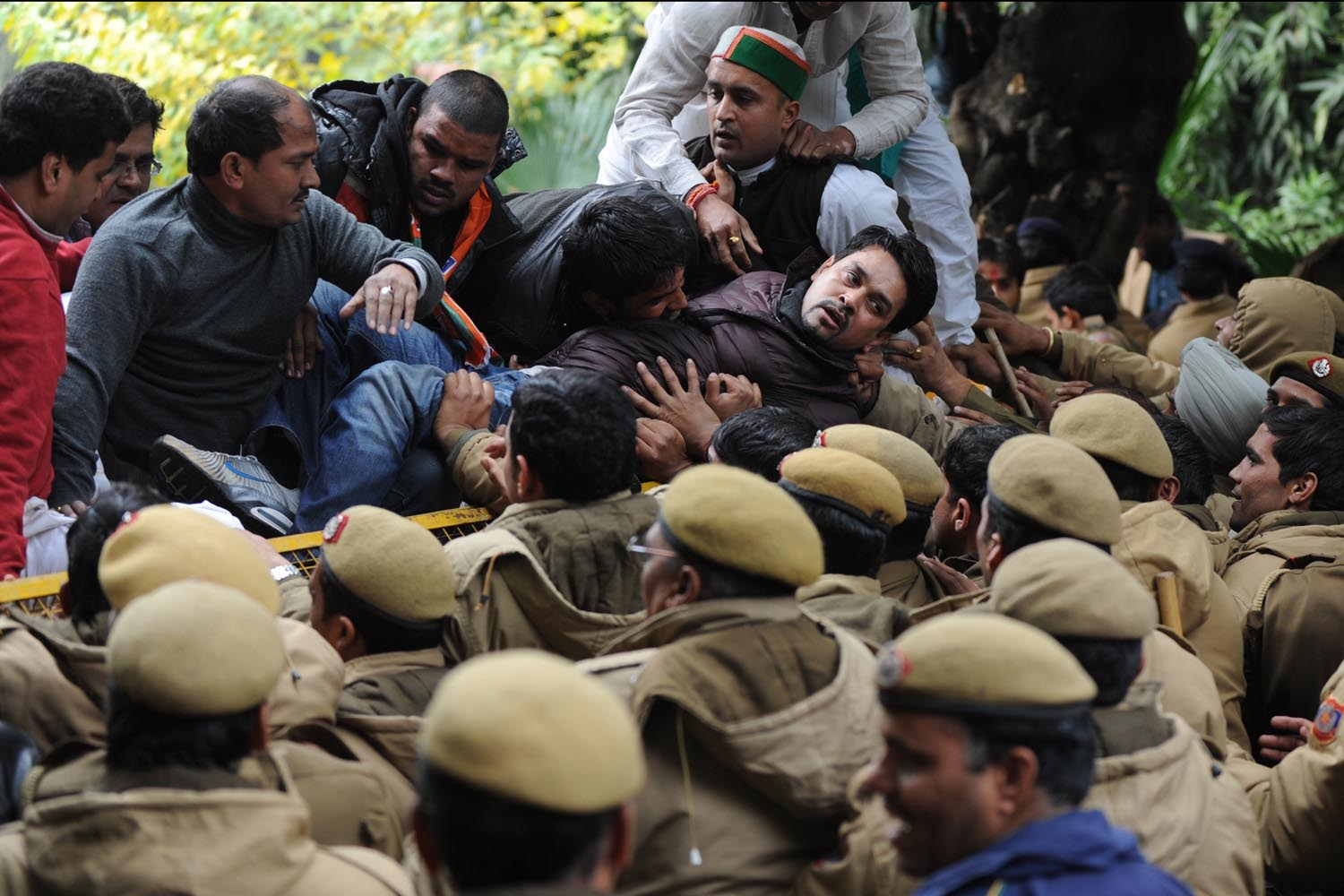 Dec. 31, 2013. Indian Bharatiya Janata Party (BJP) leader Anurag Thakur (C) tries to cross a police barricade during a protest outside Congress Vice President Rahul Gandhi's residence in New Delhi, India.