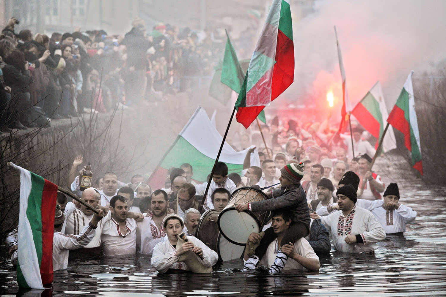 Jan. 6, 2014. Men perform a traditional dance in the icy winter waters of the Tundzha river in the town of Kalofer as part of the Epiphany Day celebrations.