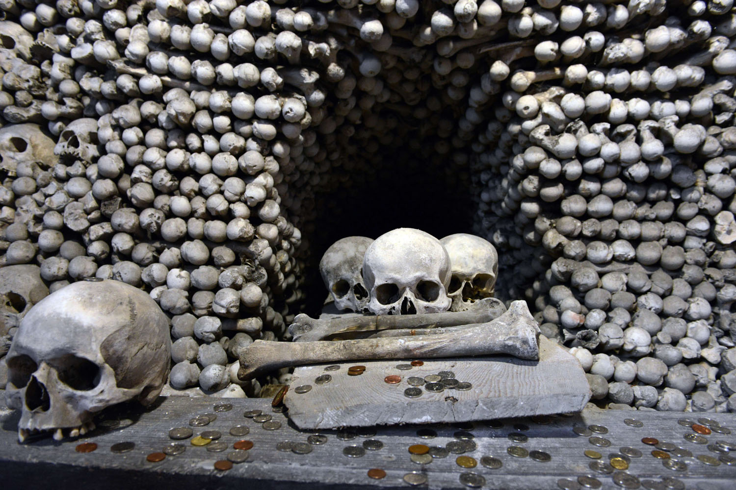 Jan. 4, 2014. Coin-offerings are seen on one of the bone pyramids in the Sedlec Ossuary chapel beneath the Cemetery Church of All Saints in Sedlec, suburb of Kutna Hora, Czech Republic.