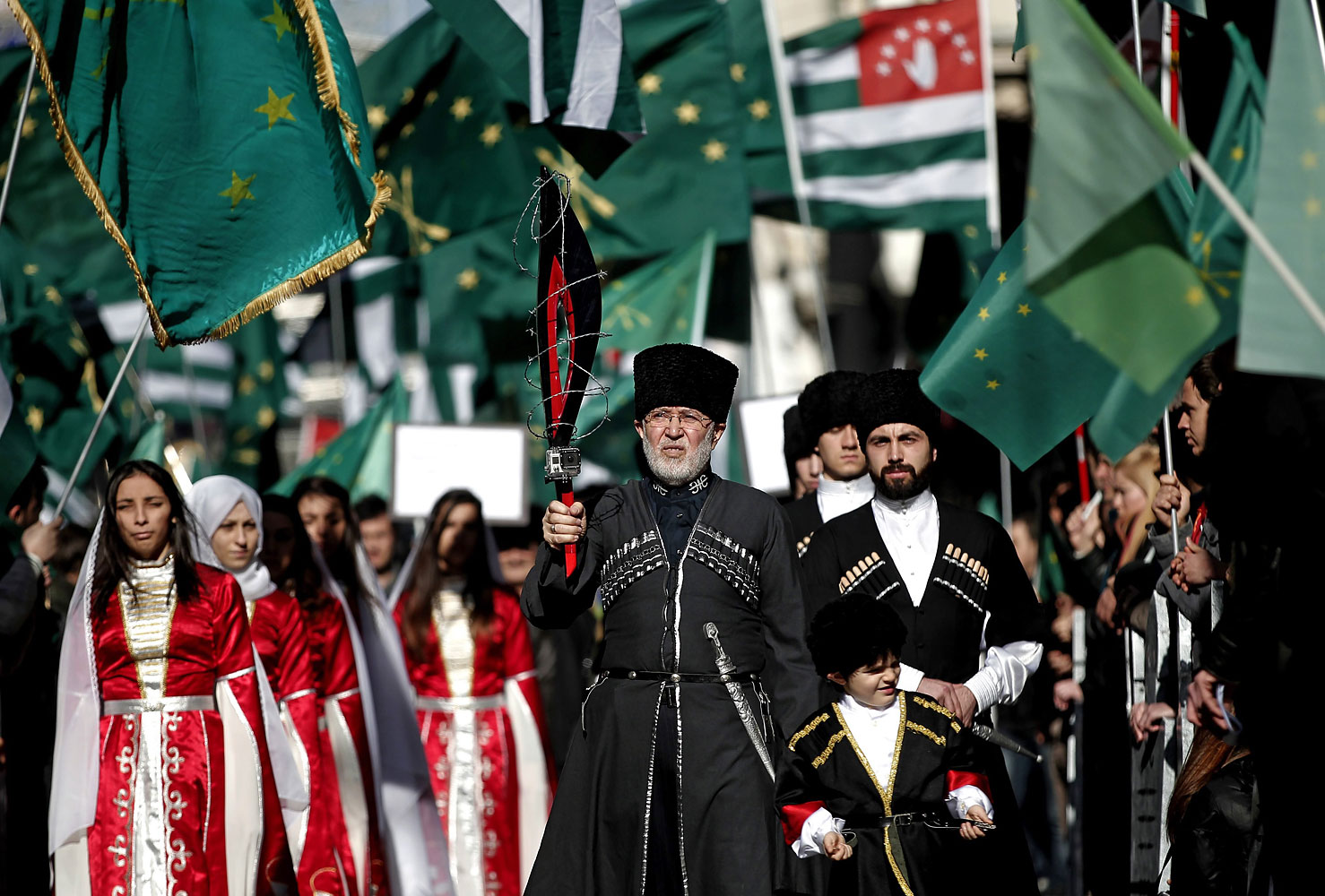 Members of a Circassian ethnic group shout slogans during a protest against the Olympics in front of the Russian Consulate in Istanbul, Feb. 2, 2014.