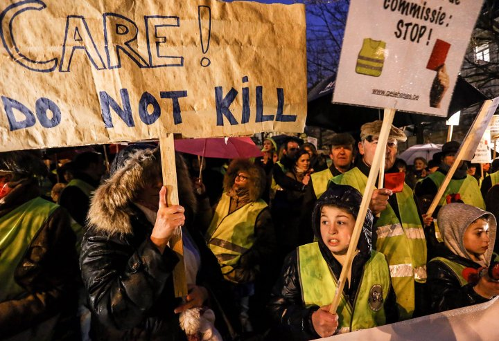Activists of the collective Yellow Safety Jacket protest against the proposed statutory amendment legalizing the euthanasia of young children, in Brussels, Feb. 11, 2014.