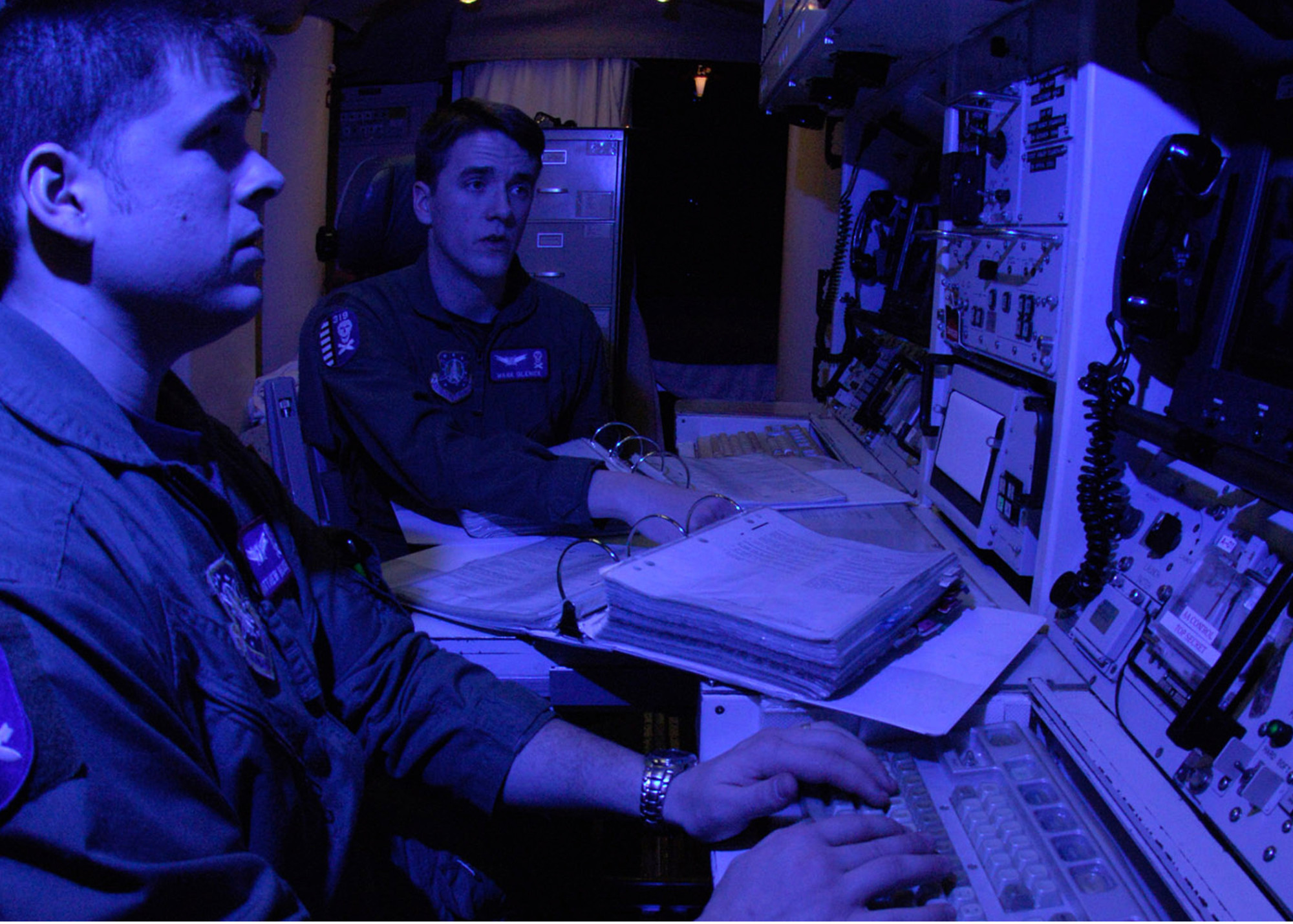 A pair of Air Force missile launch control officers, having passed their monthly proficiency tests, pull alert at a Minuteman III missile site.
