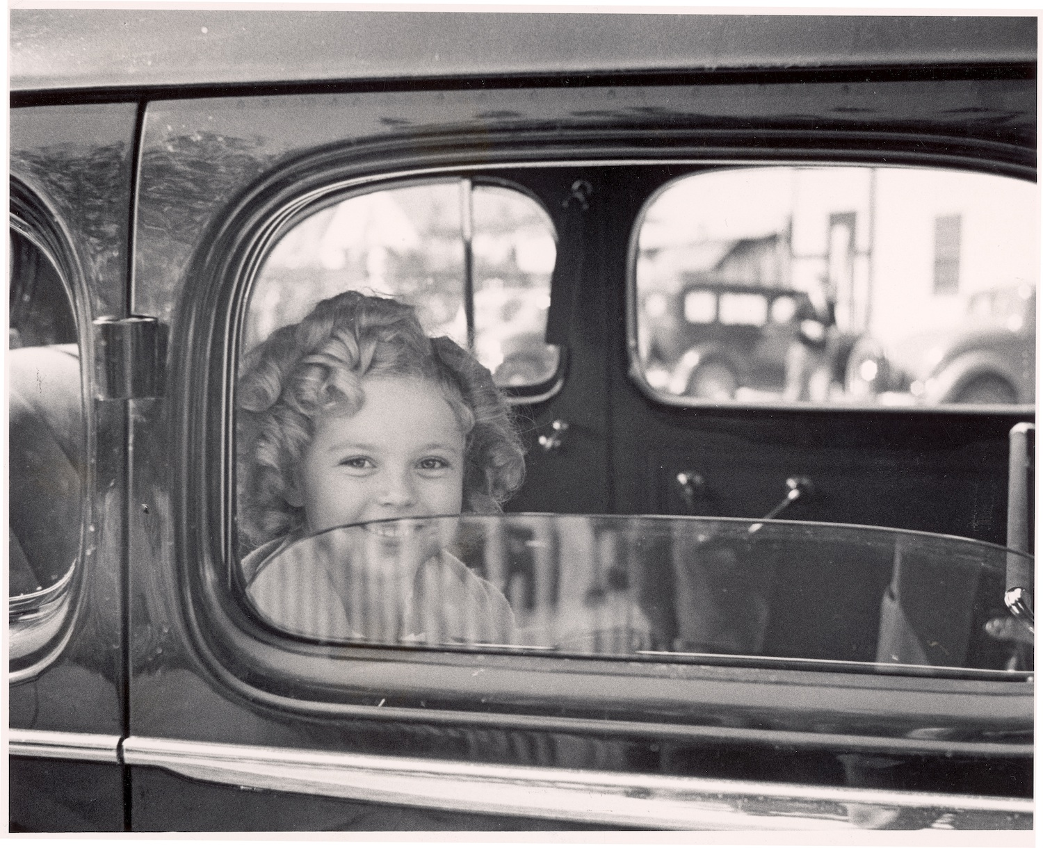 Shirley Temple arriving at 20th Century Fox film studio lot to celebrate her eighth birthday, in 1936.
