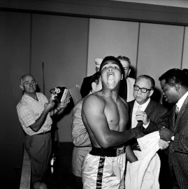 Cassius Clay weighs in before his 1964 heavyweight title bout with Sonny Liston.