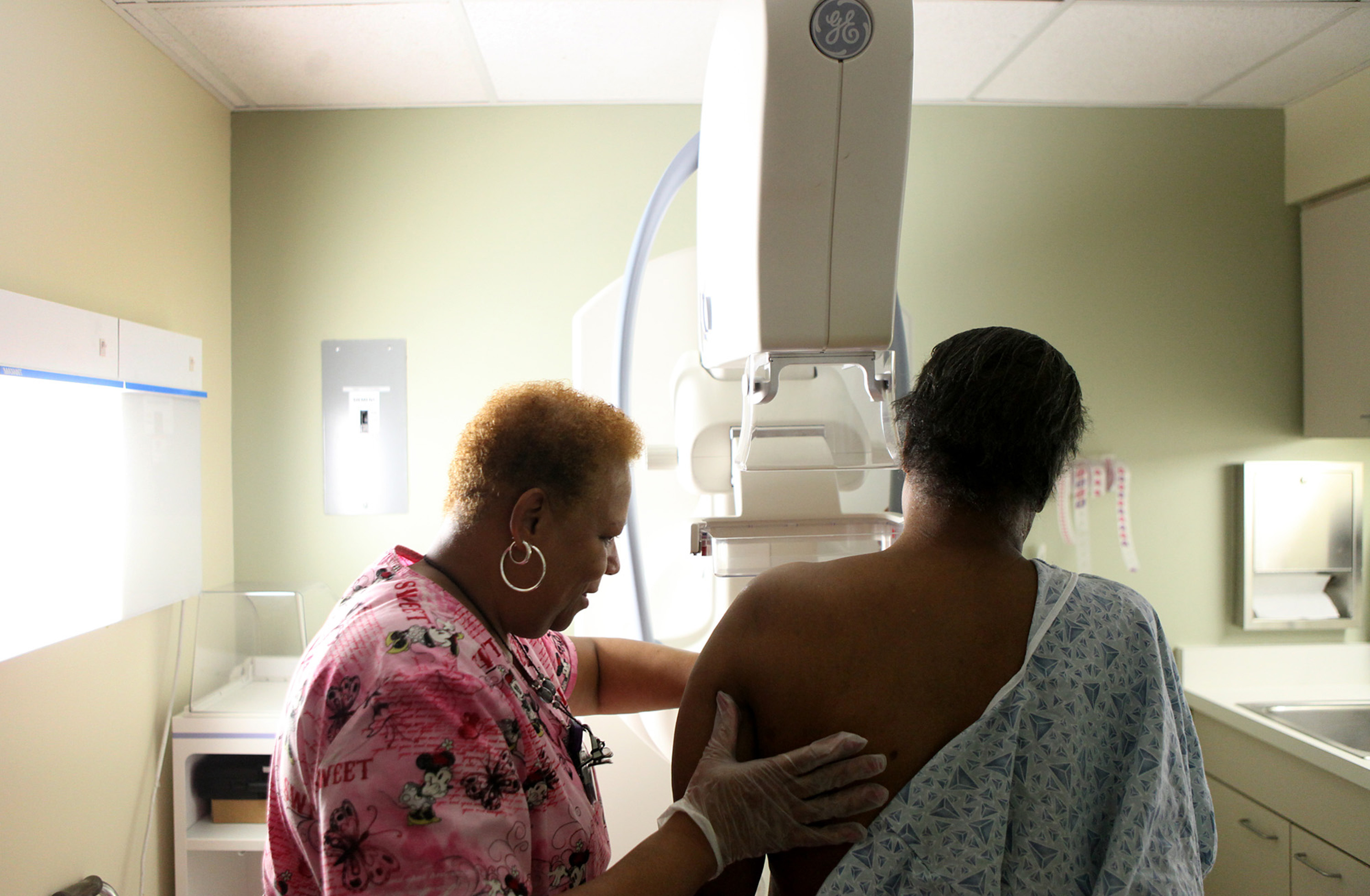 Betty Daniel, right, of Chicago, gets her routine yearly mammogram from Lead Mammography Tech Stella Palmer at Mt. Sinai Hospital in Chicago, February 15, 2012.