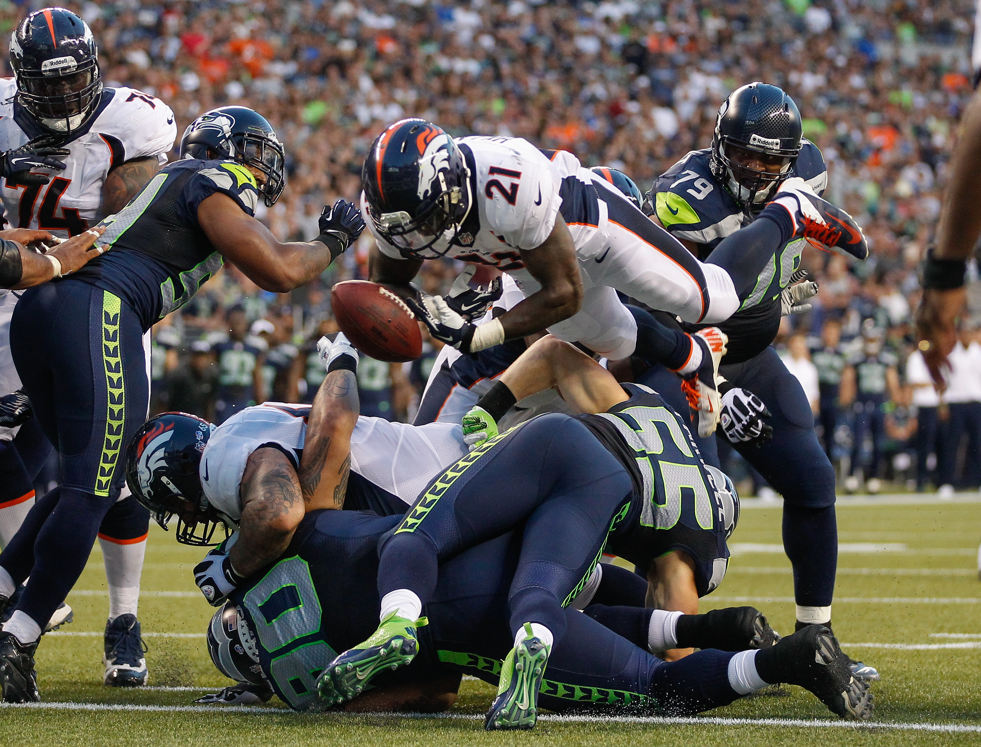 Running back Ronnie Hillman #21 of the Denver Broncos fumbles at the goal line against the Seattle Seahawks at CenturyLink Field on August 17, 2013 in Seattle, Washington.