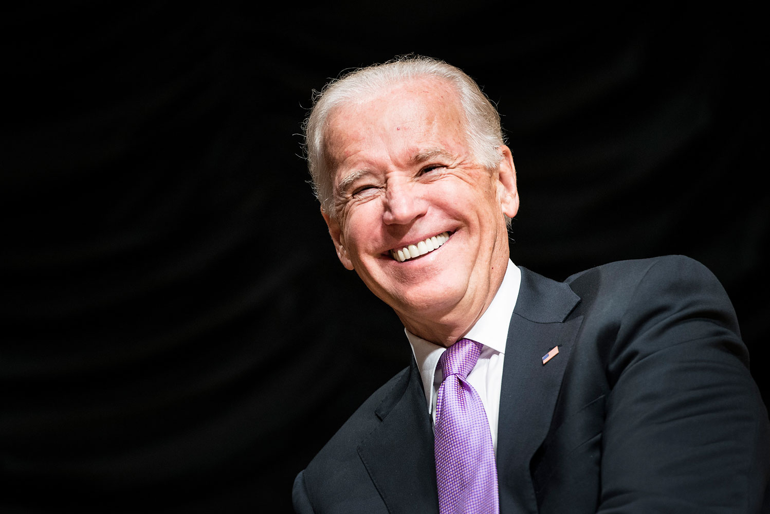 US Vice President Joe Biden smiles during a farewell ceremony during a farewell ceremony for Homeland Security Secretary Janet Napolitano at the Ronald Reagan Building Sept. 6, 2013 in Washington, DC.