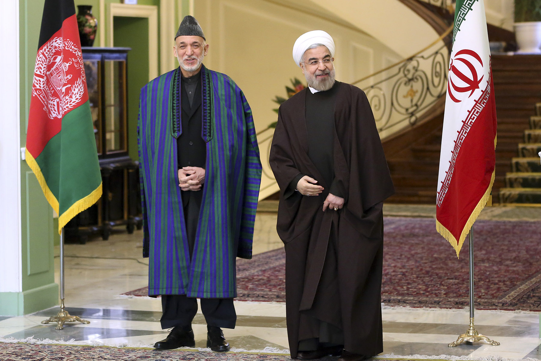 Iran's President Hassan Rouhani, right, stands with Afghan President Hamid Karzai, Sunday, Dec. 8, 2013. On Karzai's watch, the Afghan economy has grown rapidly, at an average rate of 9.2% from 2003 to 2012. But only 27% of Afghans have access to safe drinking water, and 5% to adequate sanitation.