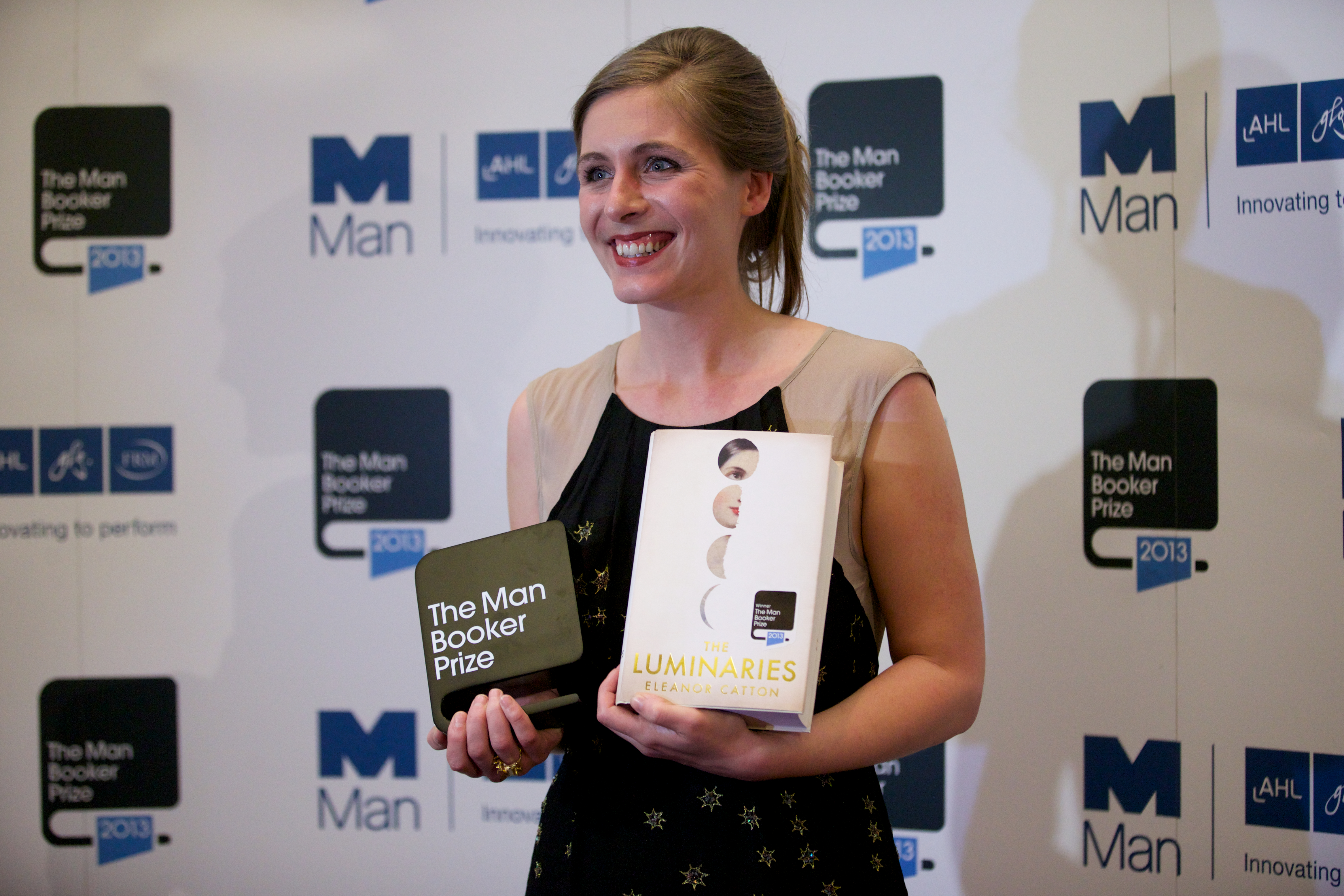 Eleanor Catton poses after winning the 2013 Man Booker Prize for Fiction for her book 'The Luminaries'