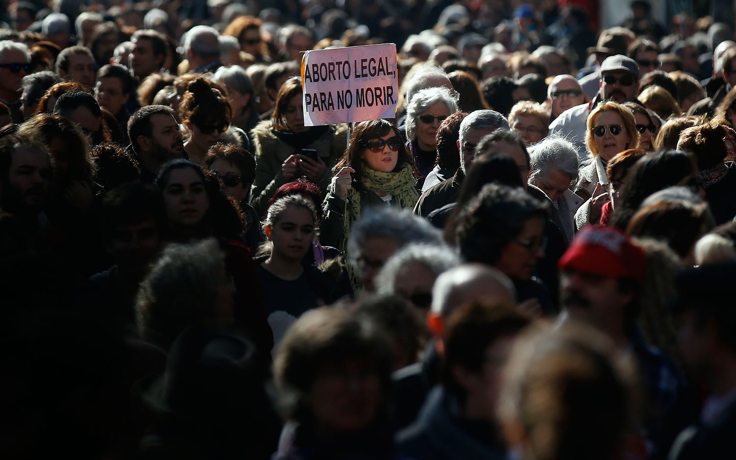 Thousands of people march to protest a government plan to limit abortions in Madrid, Feb. 1, 2014.