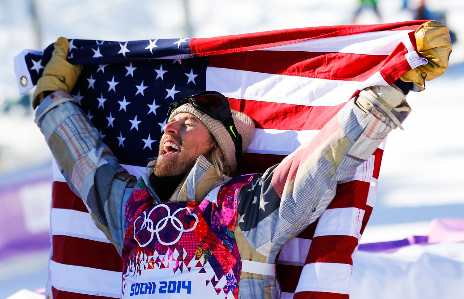 Winner Sage Kotsenburg of the U.S. celebrates after the men's snowboard slopestyle final competition at the 2014 Sochi Olympic Games in Rosa Khutor, Feb. 8, 2014.