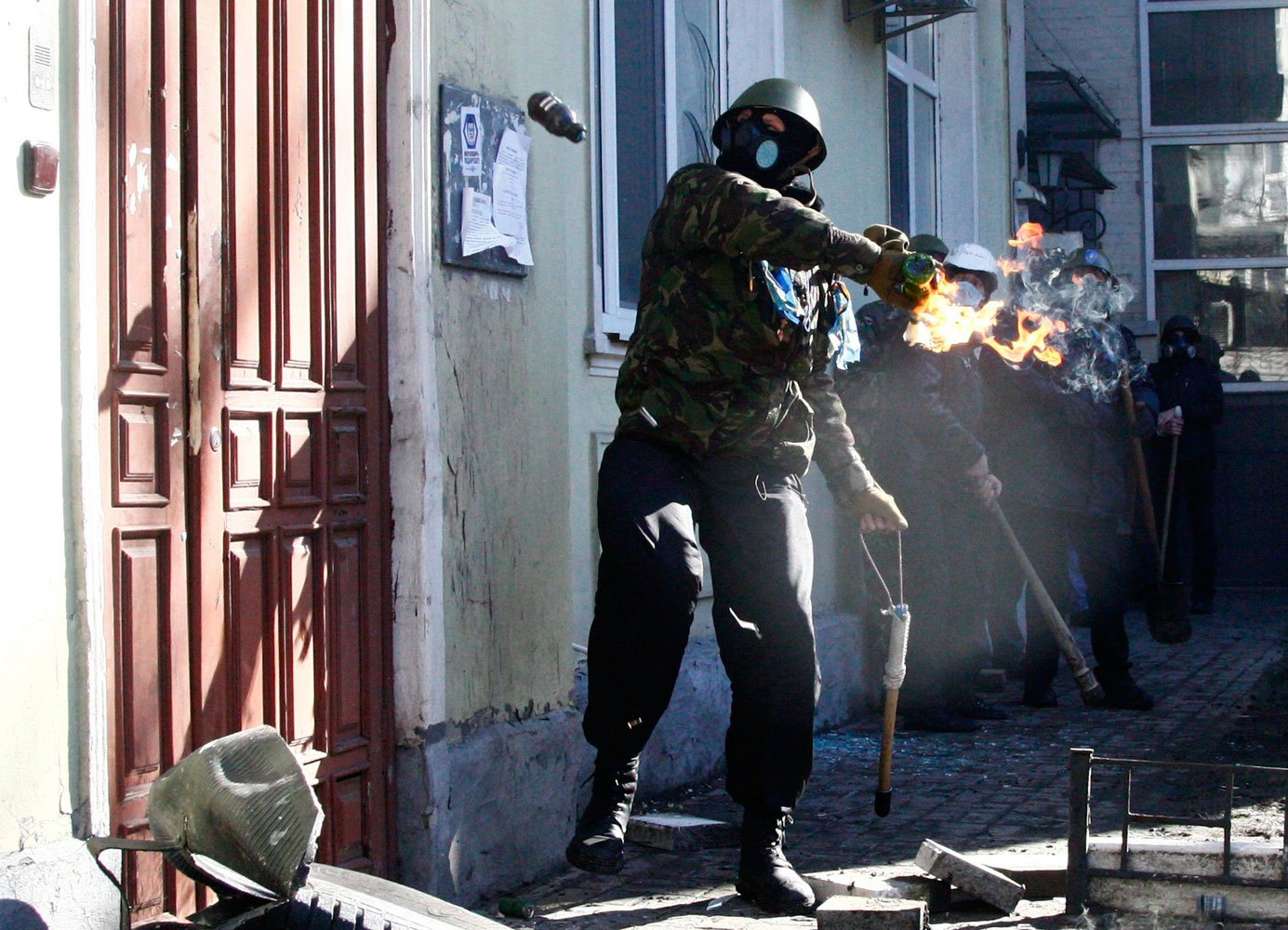 An anti-government protester holds a Molotov cocktail during clashes with Interior Ministry members in Kiev, on Feb. 18, 2014.