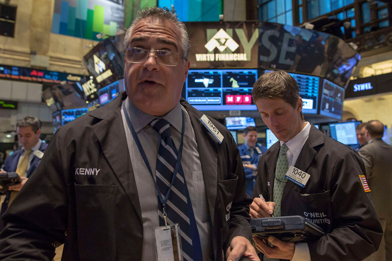 Traders work on the floor of the New York Stock Exchange, Feb. 24, 2014.
