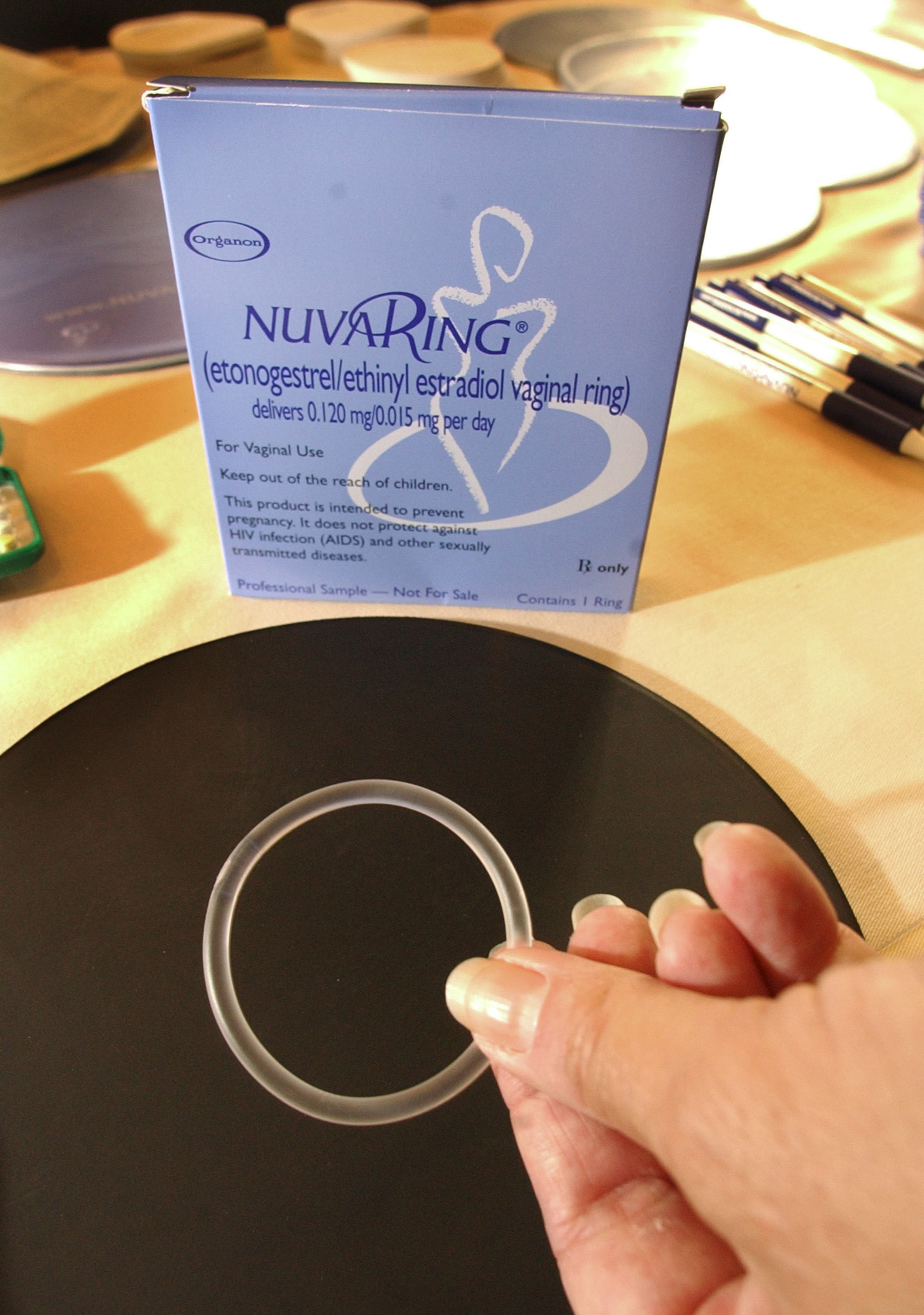 Organon representetive Sandy Wingfield shows-off a NuvaRing contraceptive September 12, 2003 at the Association of Reproductive Health Professional convention in La Jolla, California