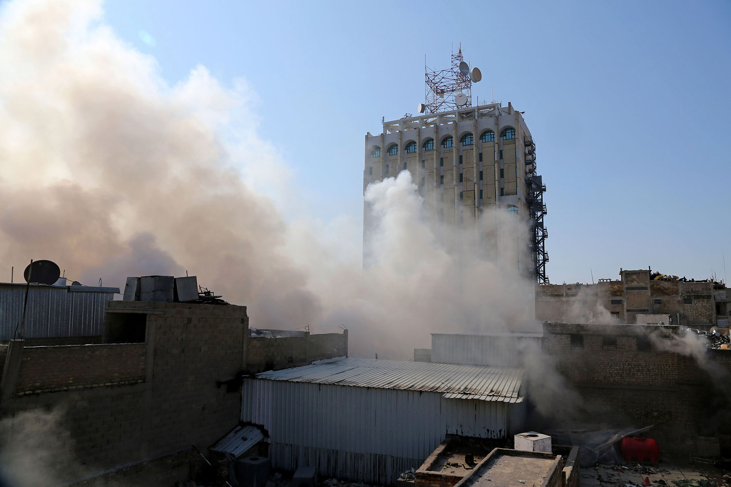 Smoke rises after a parked car bomb went off at a commercial center in Khilani Square in central Baghdad, Feb. 5, 2014.