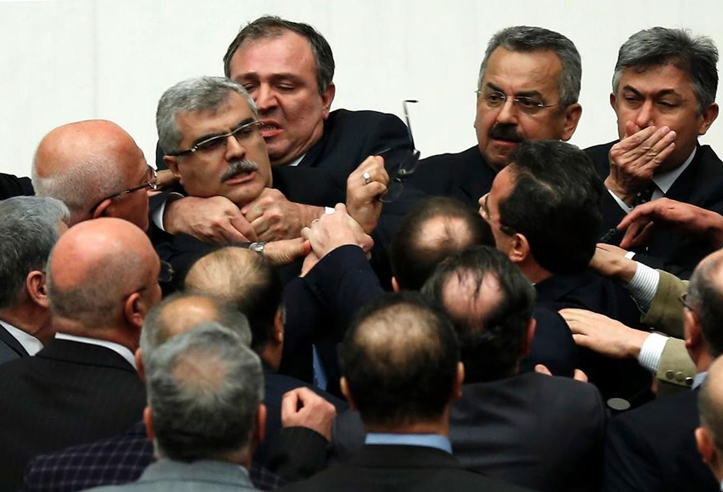 Turkish legislators from Prime Minister Recep Tayyip Erdogan's ruling party and the main opposition Republican People's Party brawl during a tense all-night debate over a controversial law on changes to a council that appoints and overseas judges and prosecutors, in Ankara, early Saturday, Feb. 15, 2014.