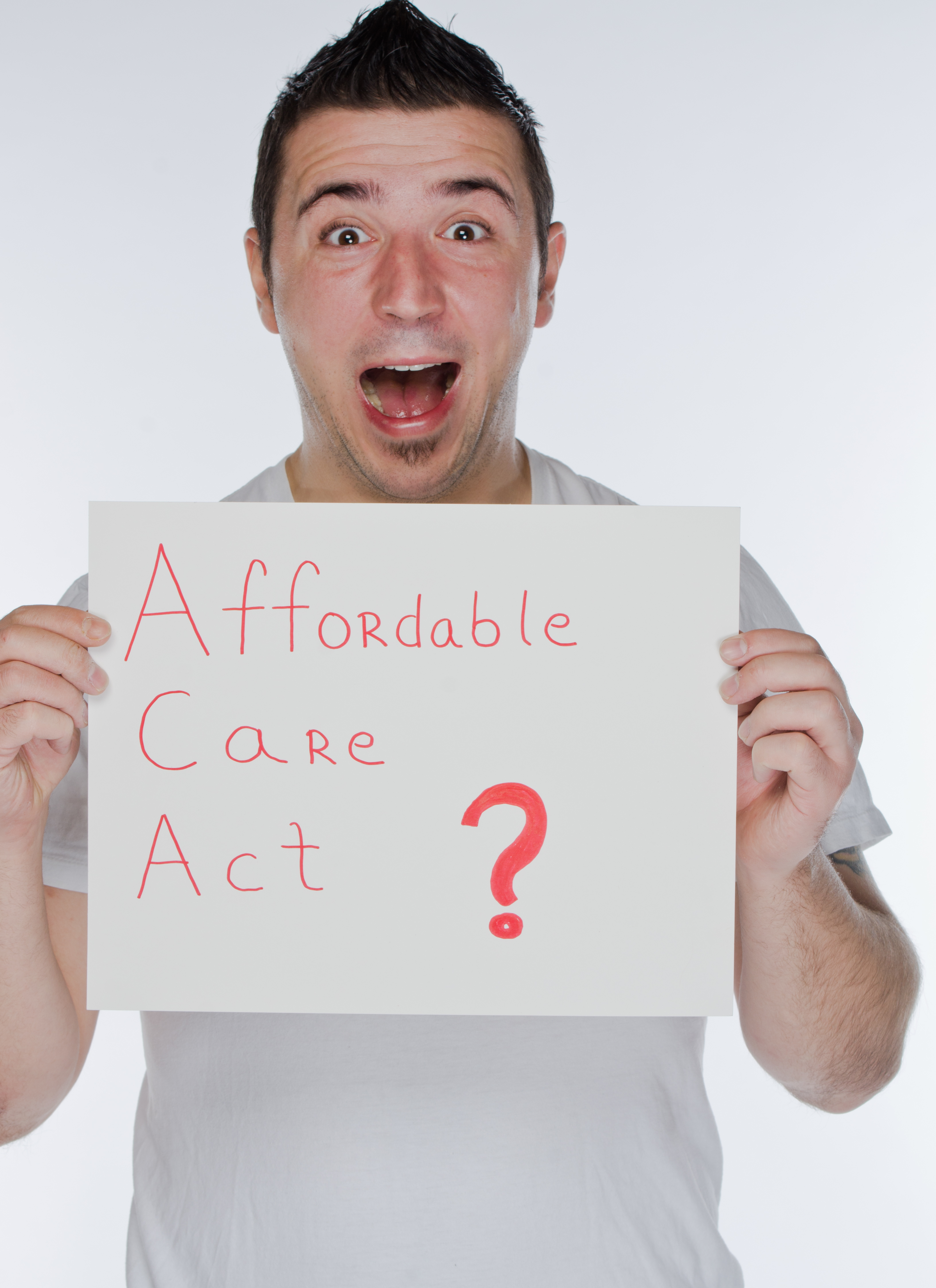 Shocked man holding 'Affordable Care Act' sign