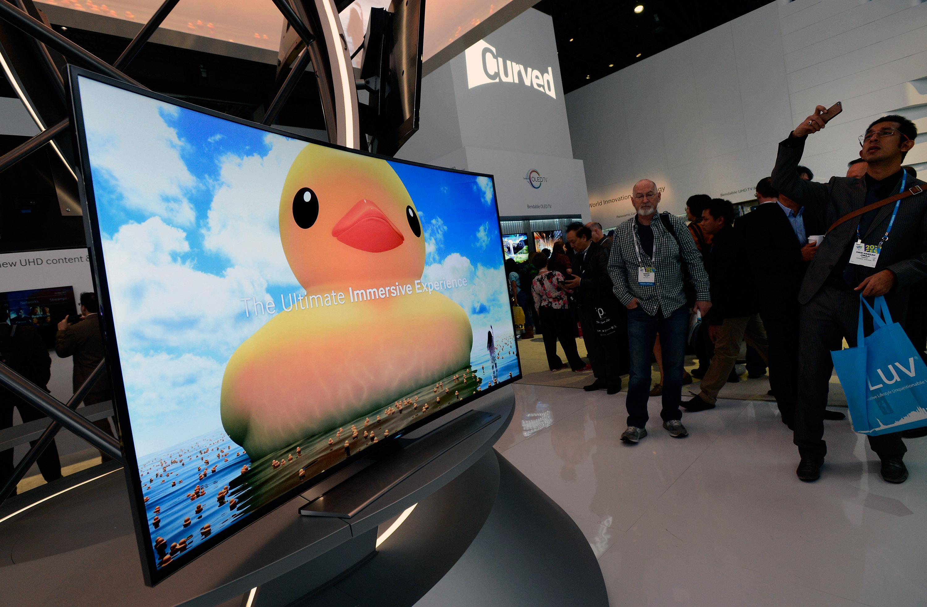 A Samsung curved OLED televison is seen on display. Ultra high-resolution TVs -- some curved and some flat -- were a mainstay at this year's show.