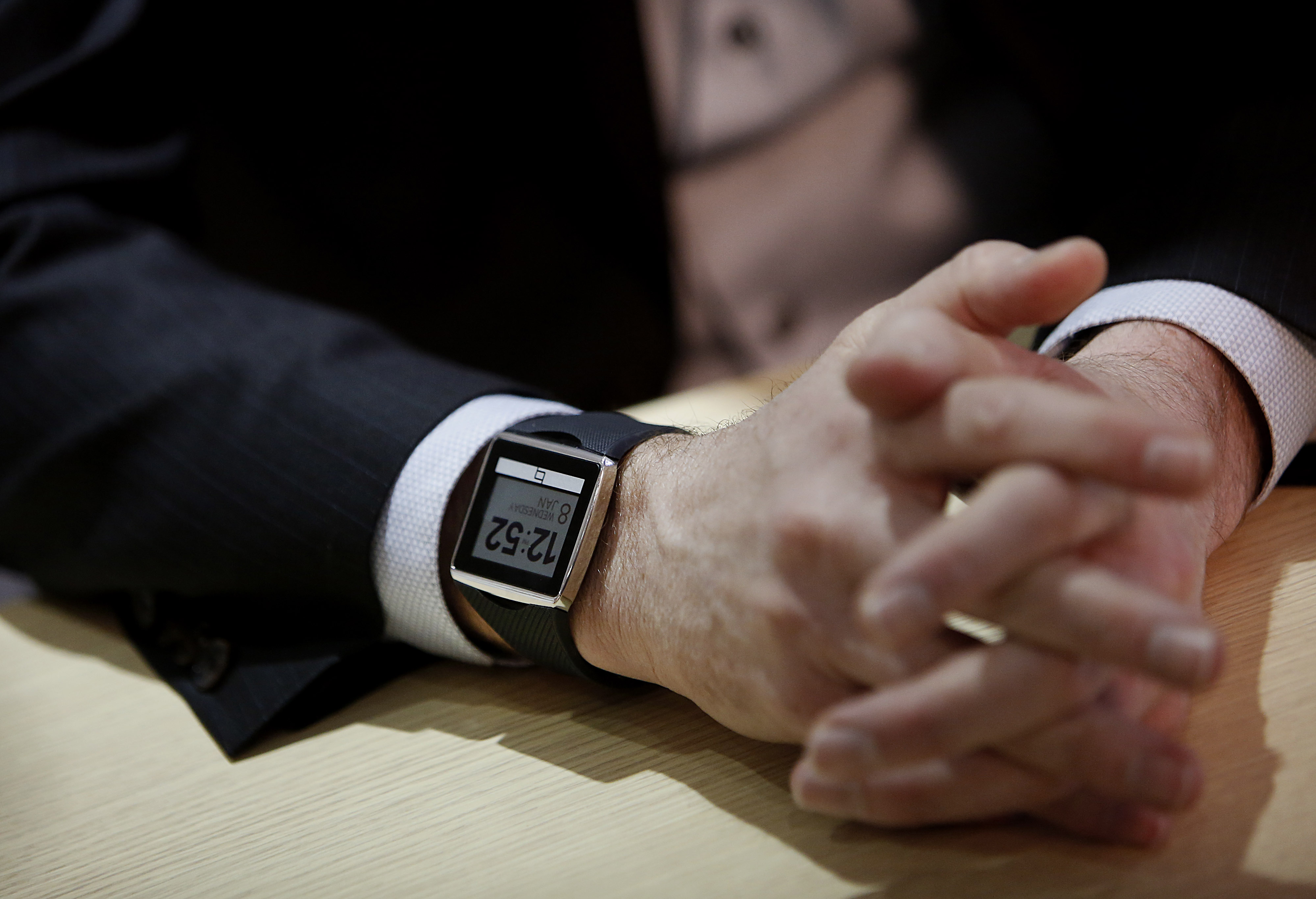 Paul Jacobs, chairman and chief executive officer of Qualcomm Inc., wears a Toq smartwatch while speaking during a Bloomberg Television interview.