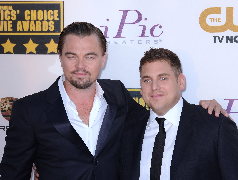 Leonardo DiCaprio and Jonah Hill arrive at the 19th Annual Critics' Choice Movie Awards at Barker Hangar on January 16, 2014 in Santa Monica, California.