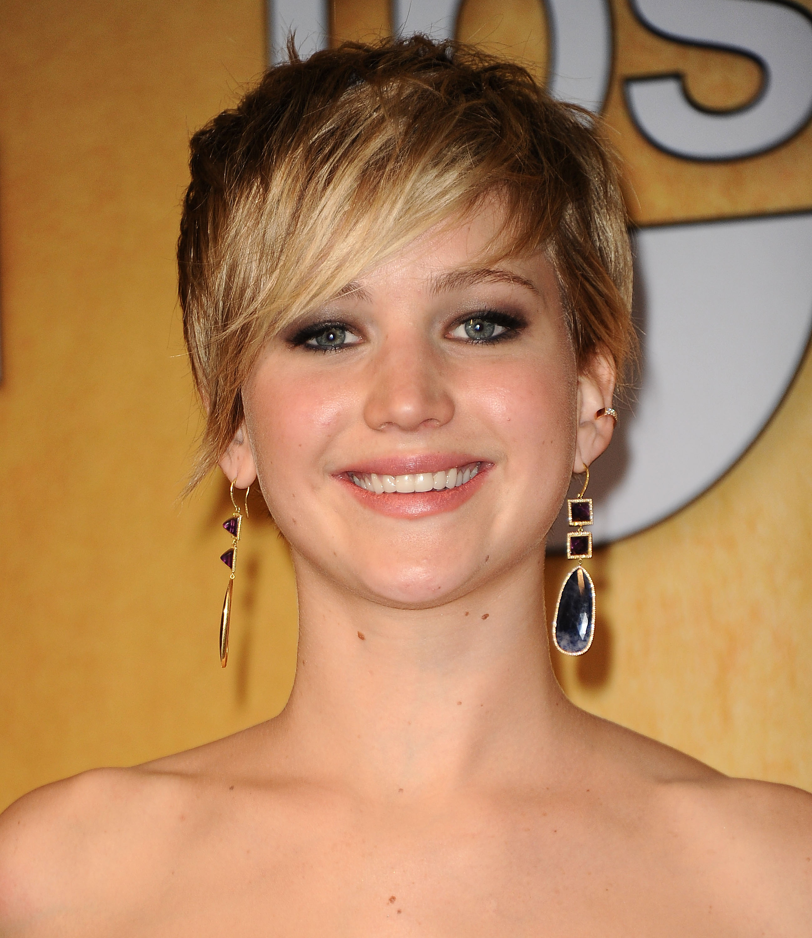 Jennifer Lawrence poses in the press room at the 20th annual Screen Actors Guild Awards on January 18, 2014 in Los Angeles, California.