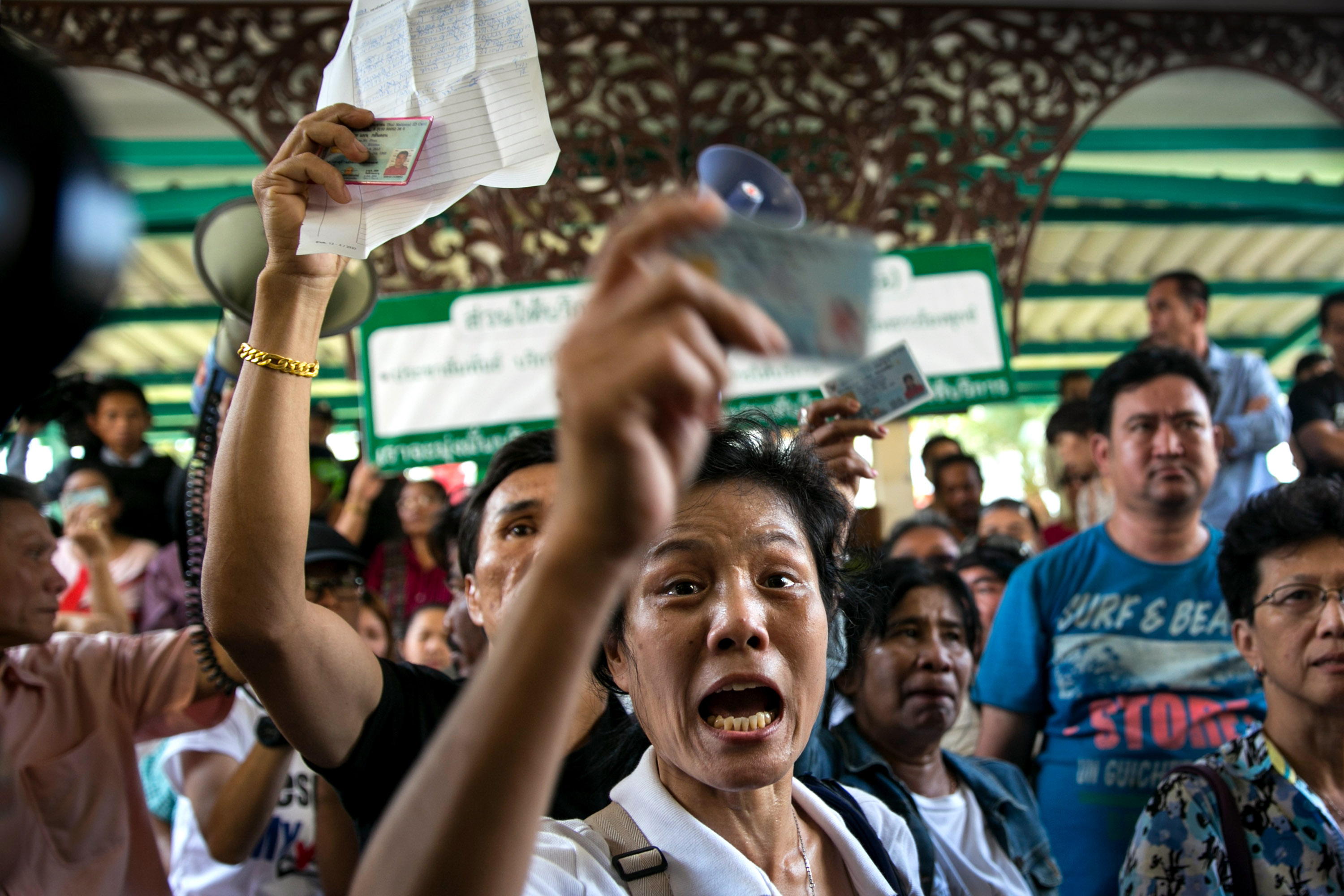 Voters in Bangkok express anger as they are unable to cast their ballots during Thailand's general elections on Feb. 2, 2014. Many polling stations were blocked by protesters
