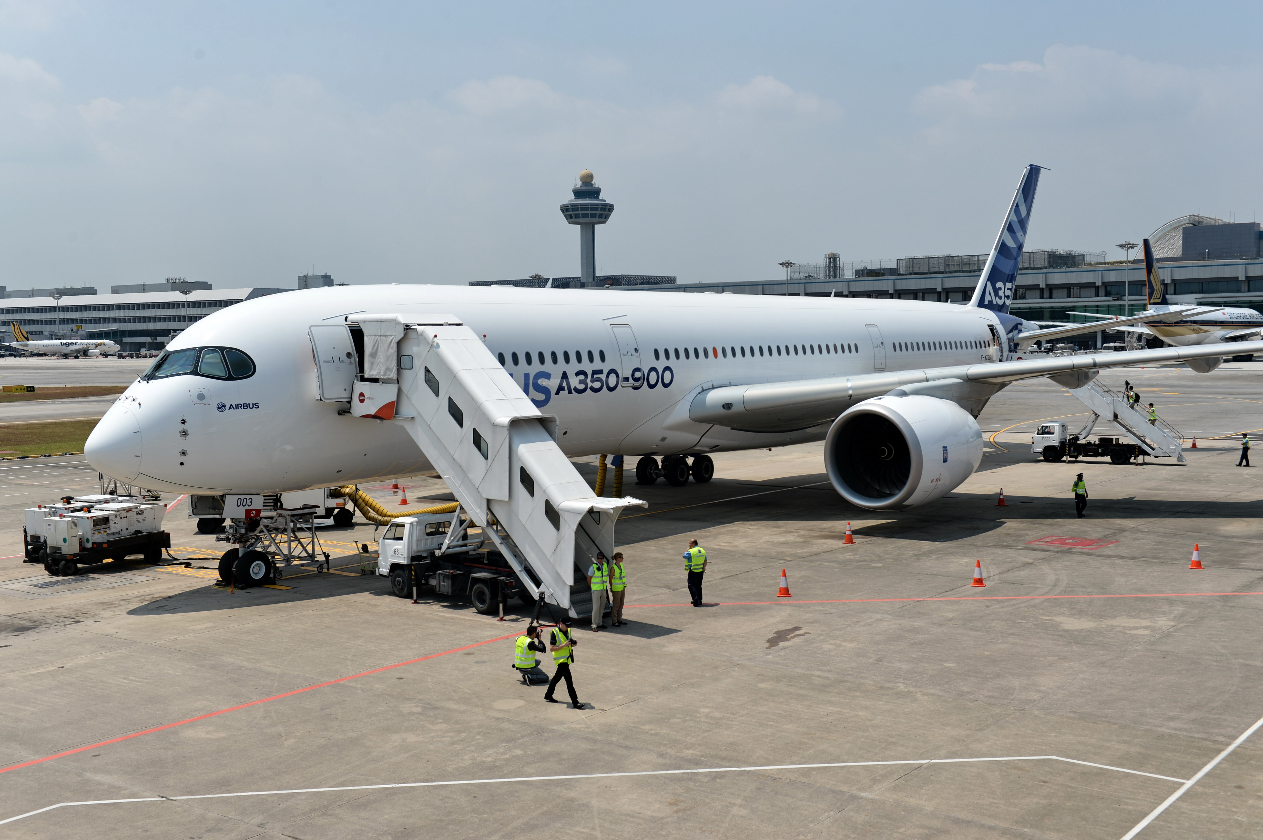 An Airbus A350-900 sits on the tarmac during a media preview at Changi Interational Airport ahead of the Singapore Airshow on Feb. 10, 2014.