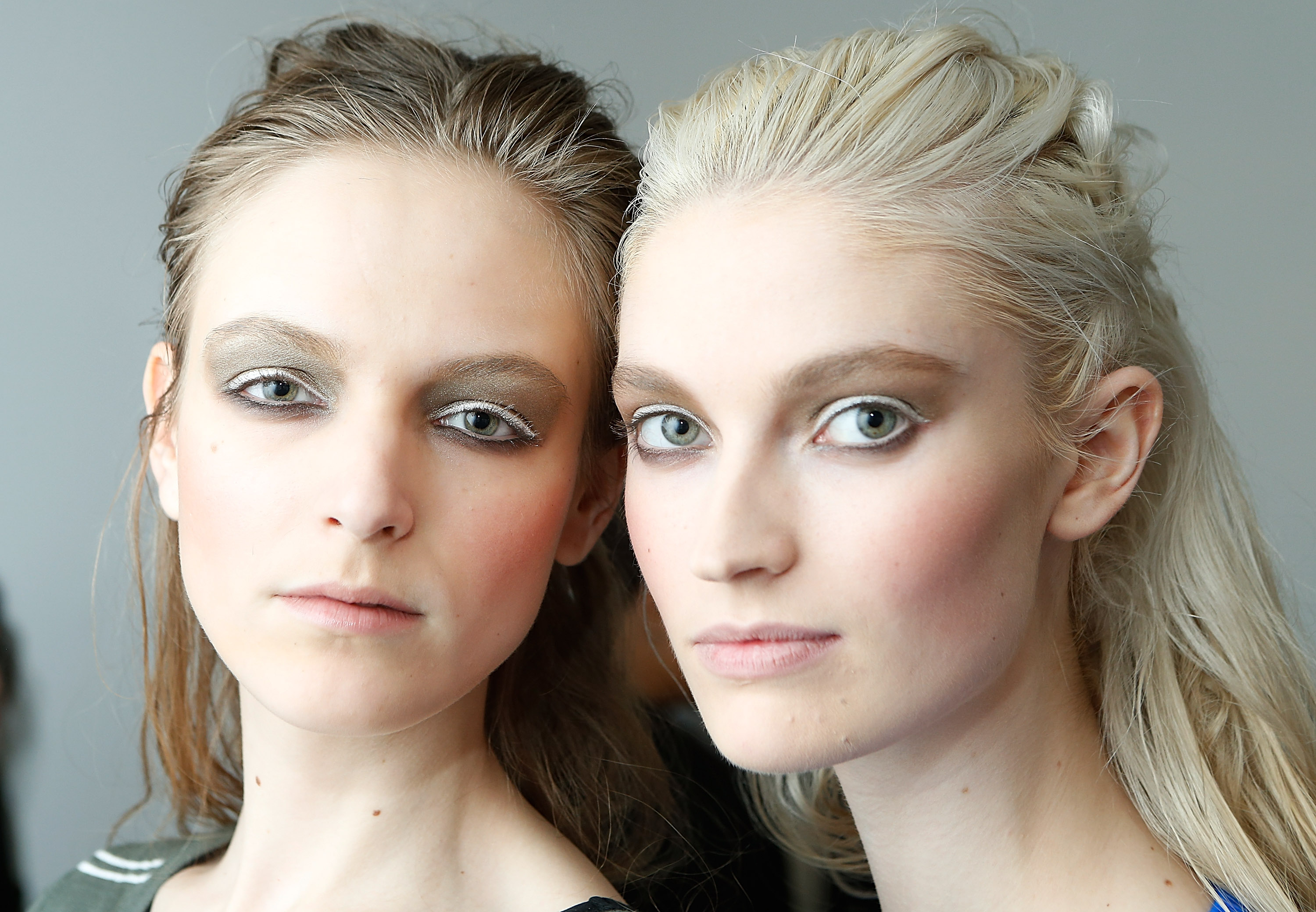 Helena Greyhorse (R) prepares backstage the Zero + Maria Cornejo show during Mercedes-Benz Fashion Week Fall 2014  on February 10, 2014 in New York City