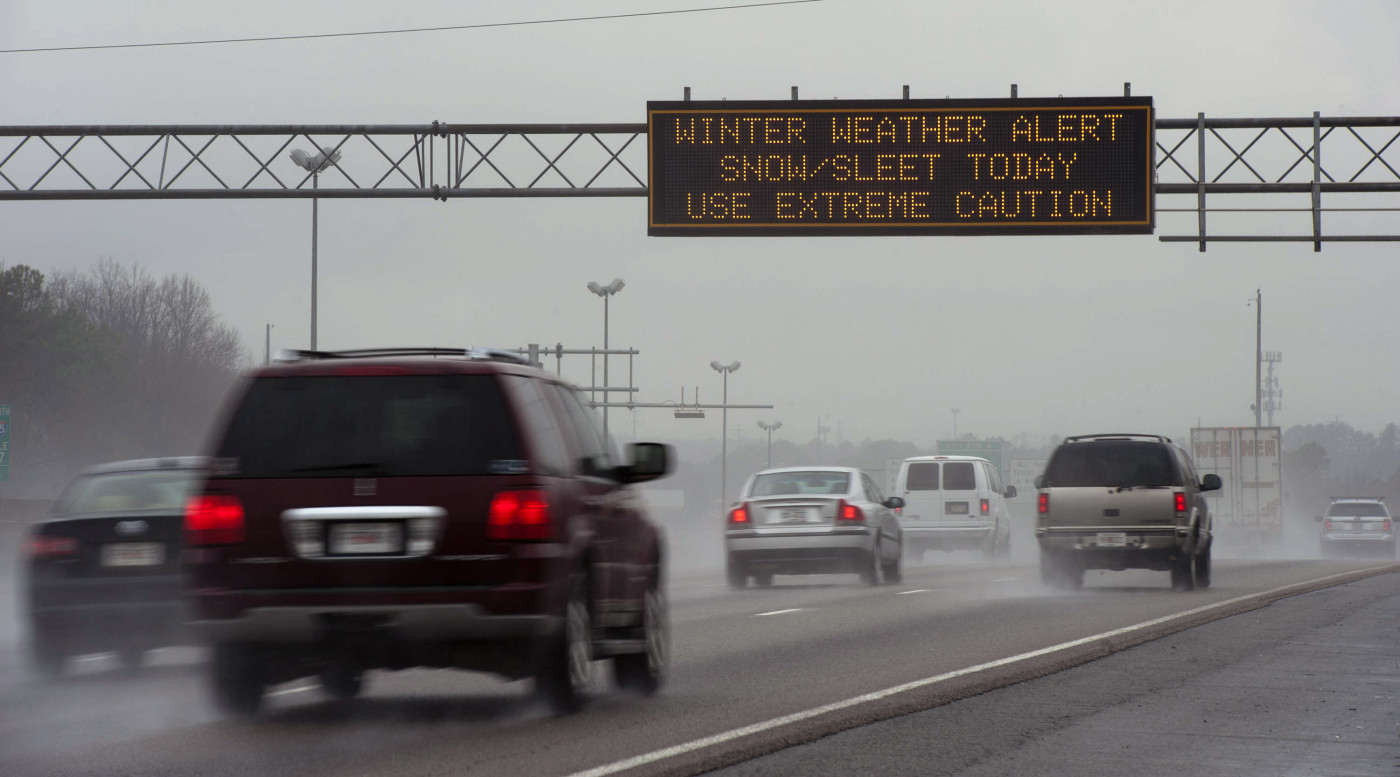 Travel advisory signs along I-85 South warn drivers of upcoming hazardous driving conditions on February 11, 2014 in Atlanta.