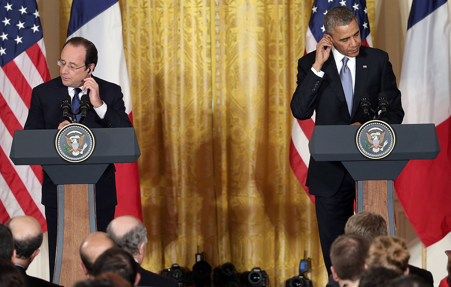 President Barack Obama and French President Francois Hollande arrive for a joint press conference in the East Room at the White House on Feb. 11, 2014 in Washington.