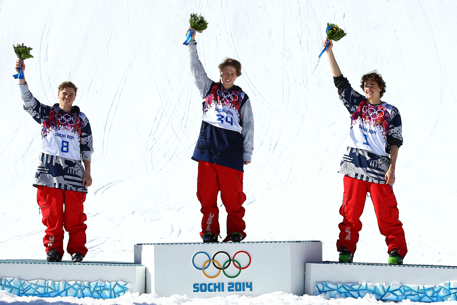 Silver medalist Gus Kenworthy of the United States, gold medalist Joss Christensen of the United States and bronze medalist Nicholas Goepper of the United States stand on the podium during the flower ceremony after the Freestyle Skiing Men's Ski Slopestyle Finals on Feb. 13, 2014 in Sochi.
