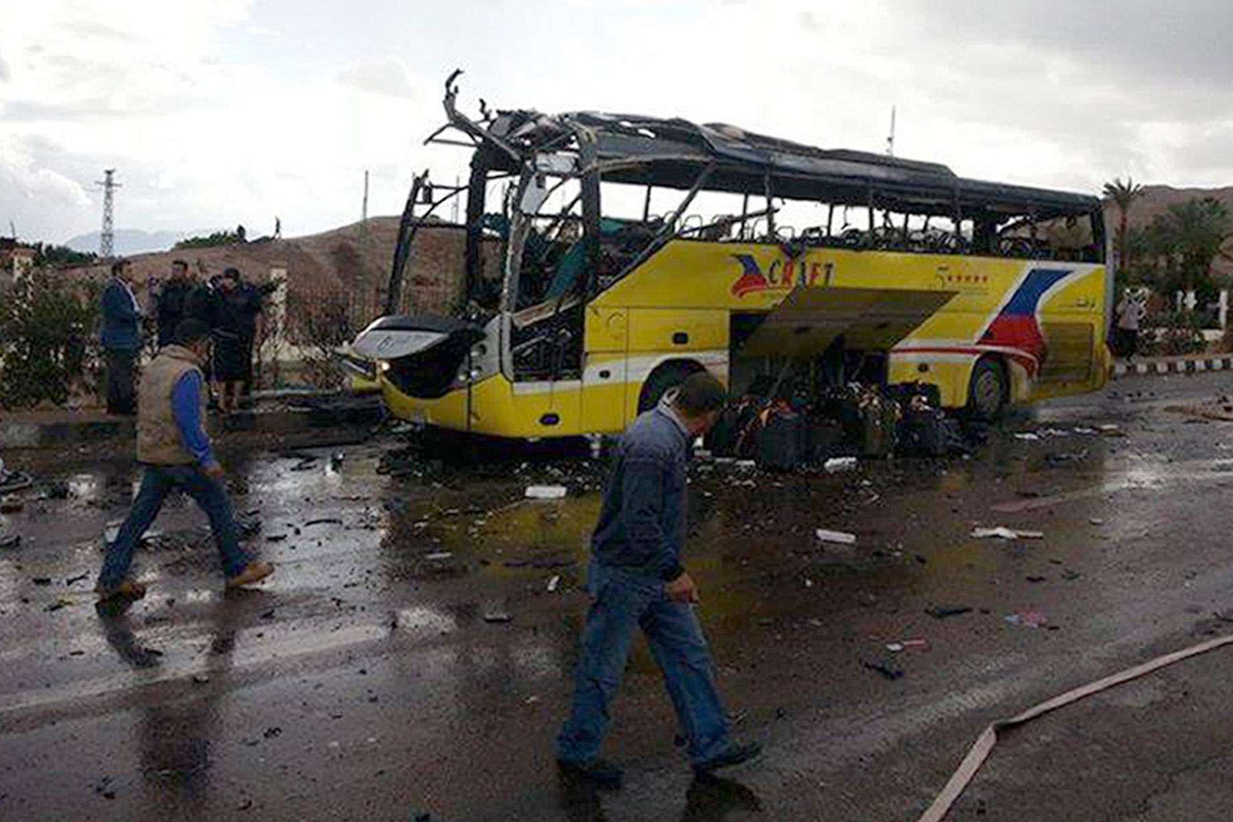 A picture taken on February 16, 2014 show the wreckage of a tourist bus at the site of a bomb explosion in the Egyptian south Sinai resort town of Taba.