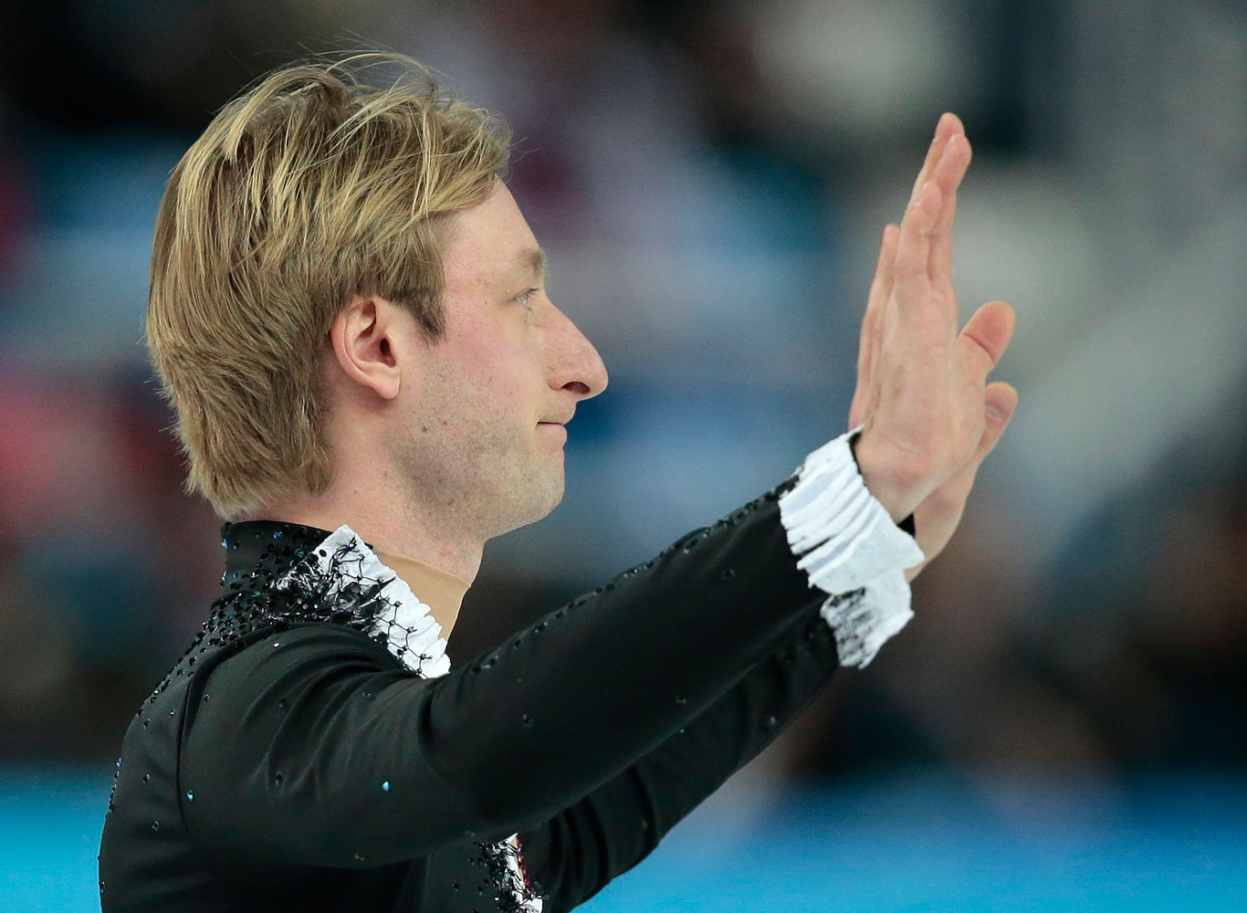 Evgeni Plushenko of Russia waves to spectators after he pulled out of the men's short program figure skating competition due to illness at the Iceberg Skating Palace, Feb. 13, 2014, in Sochi, Russia.