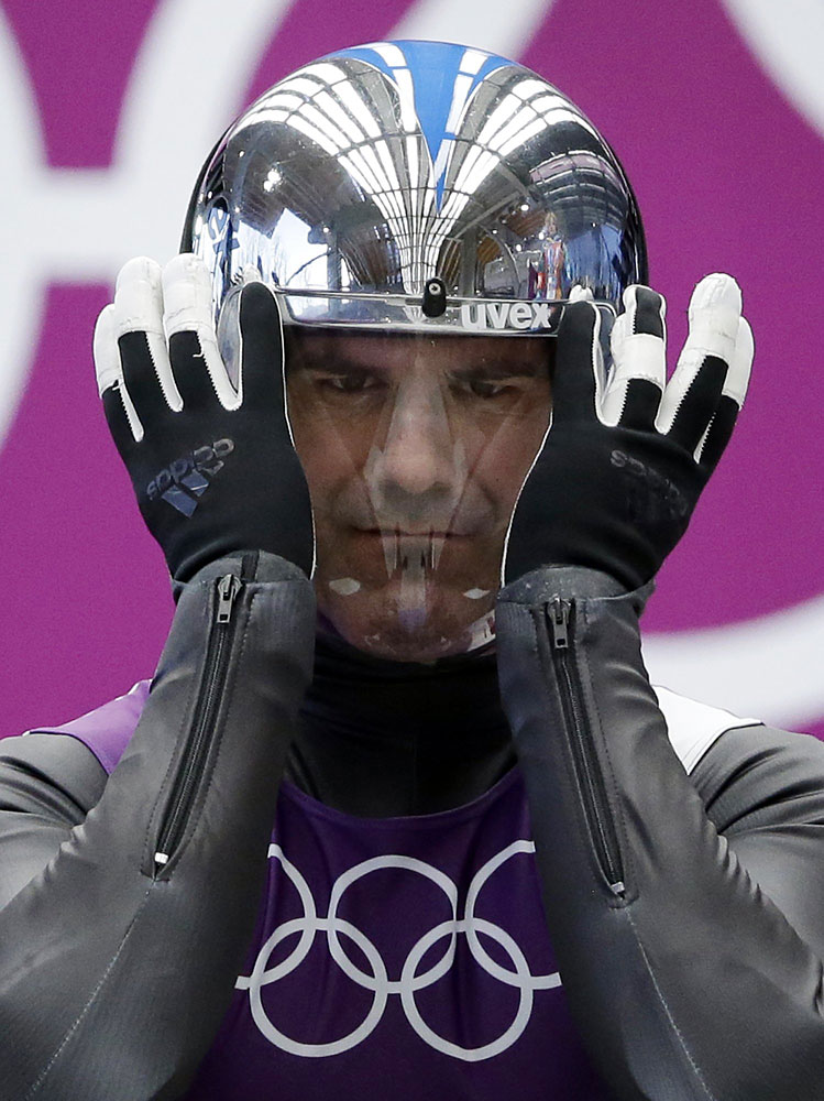 Armin Zoeggeler of Italy prepares to start his run during a training session for the men's singles luge at the 2014 Winter Olympics, Feb. 6, 2014, in Krasnaya Polyana, Russia.