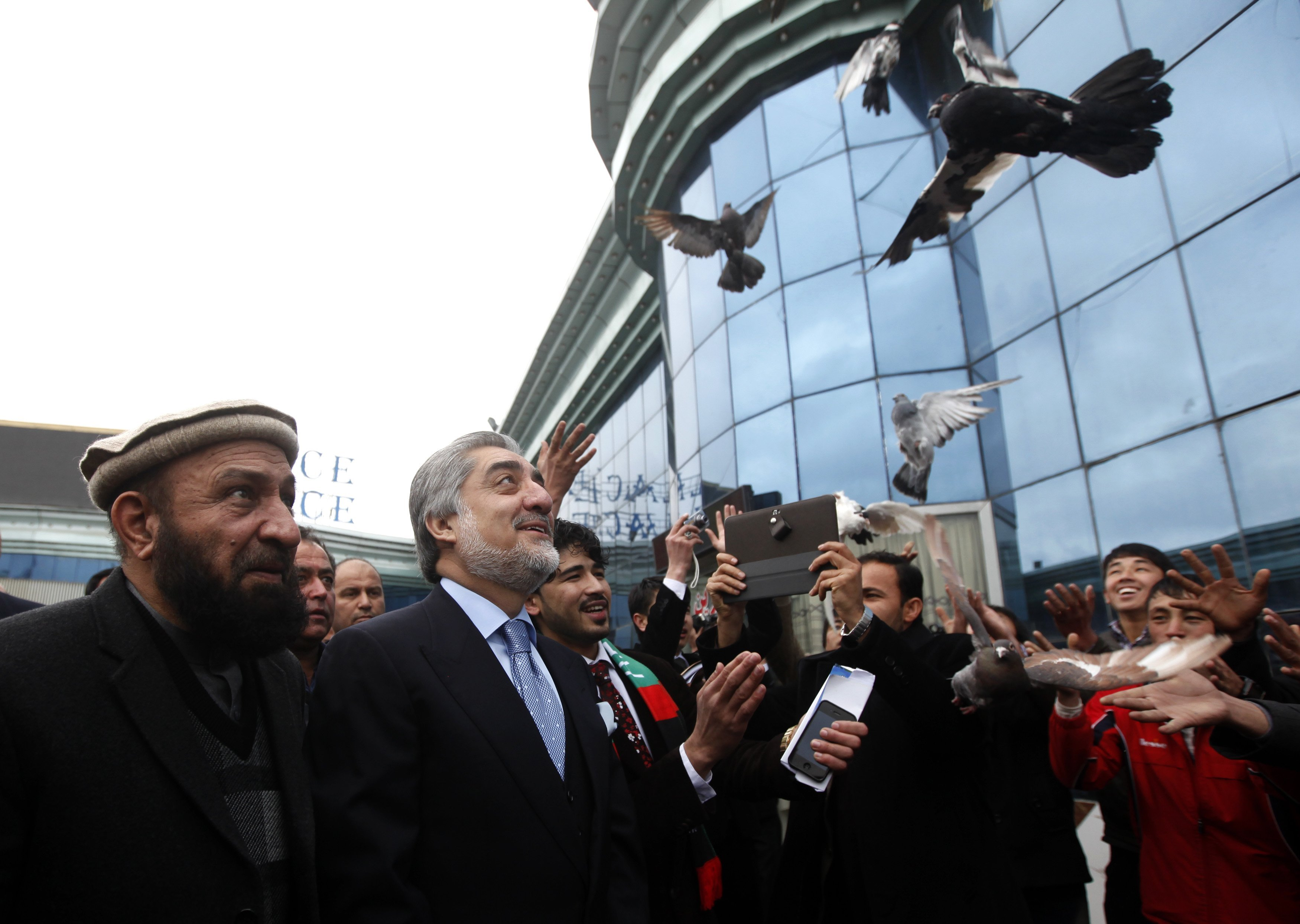 Supporters of Afghan presidential candidate Abdullah Abdullah release pigeons during the first day of the presidential election campaign in Kabul.