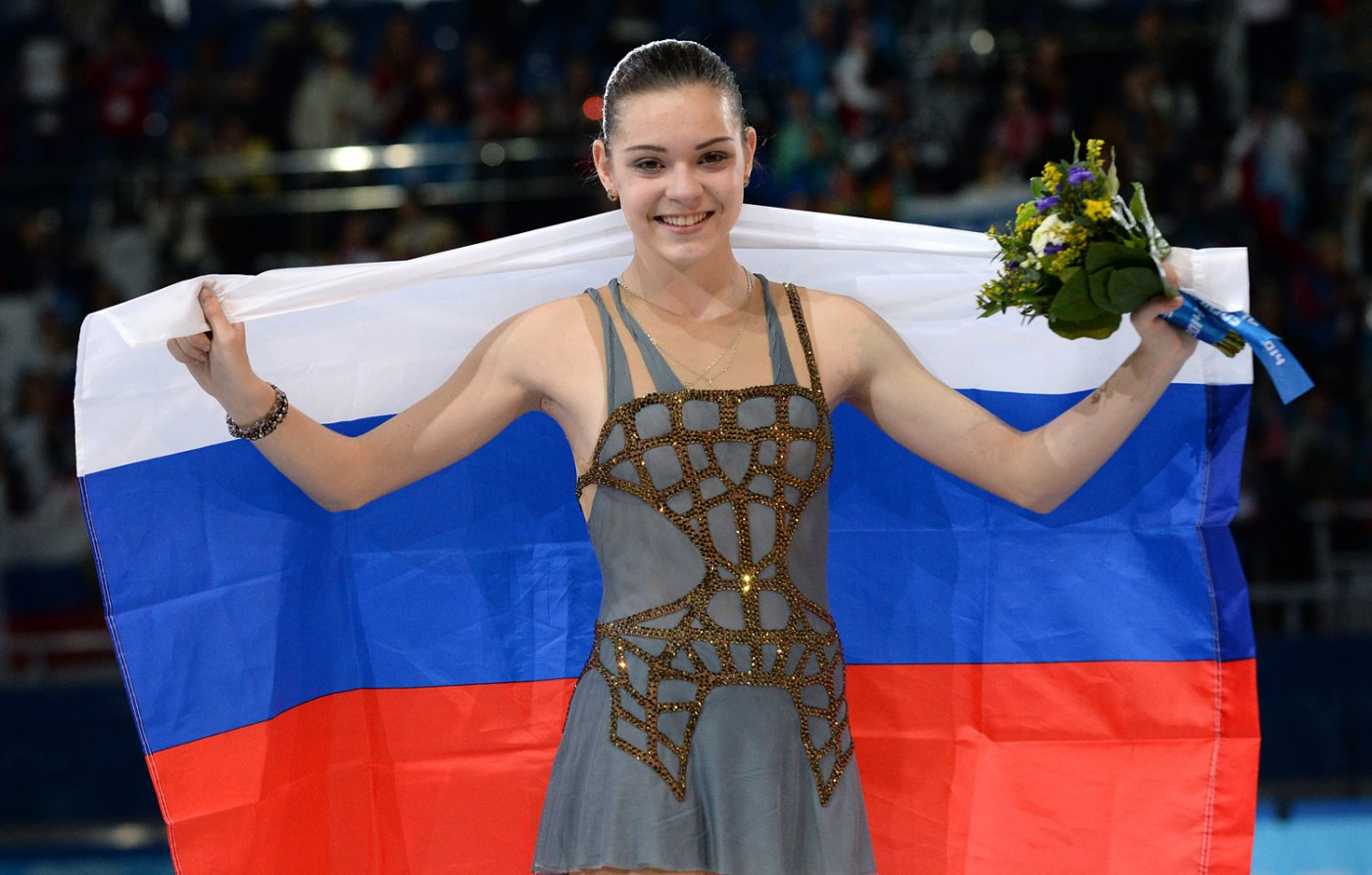 Russia's gold medalist Adelina Sotnikova celebrates during the Women's Figure Skating Flower Ceremony at the Iceberg Skating Palace during the Sochi Winter Olympics on February 20, 2014.