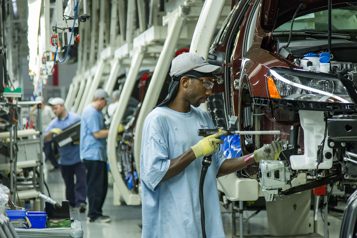 In this June 12, 2013, photo, workers assemble Volkswagen Passat sedans at the German automaker's plant in Chattanooga, Tenn.