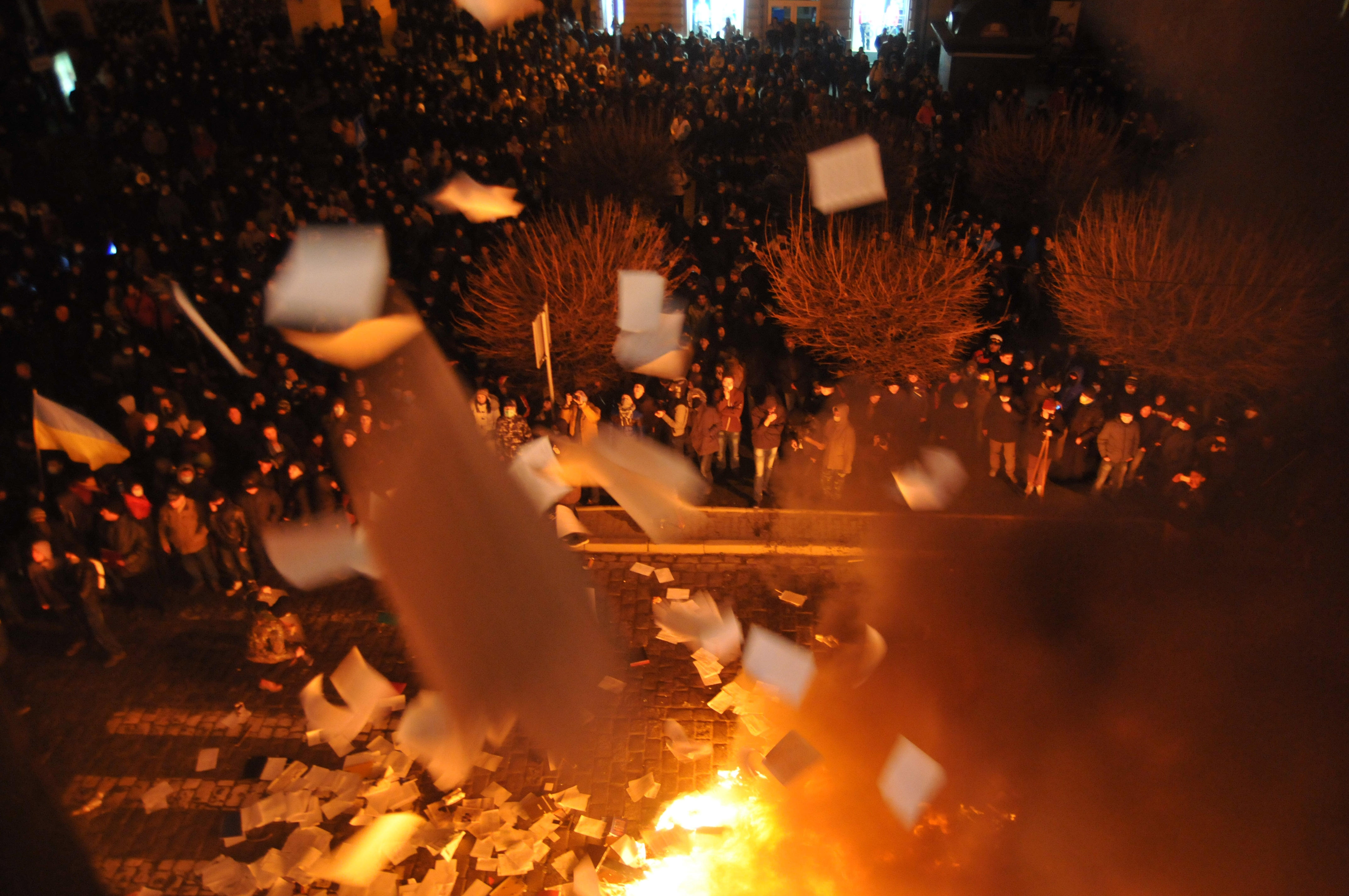 Ukrainian protesters throw out and burn papers from prosecutor's headquarters in Lviv, western Ukraine, early Wednesday, Feb. 19, 2014. The violence on Tuesday was the worst in nearly three months of anti-government protests that have paralyzed Ukraine's capital, Kiev, in a struggle over the identity of a nation divided in loyalties between Russia and the West, and the worst in the country's post-Soviet history.