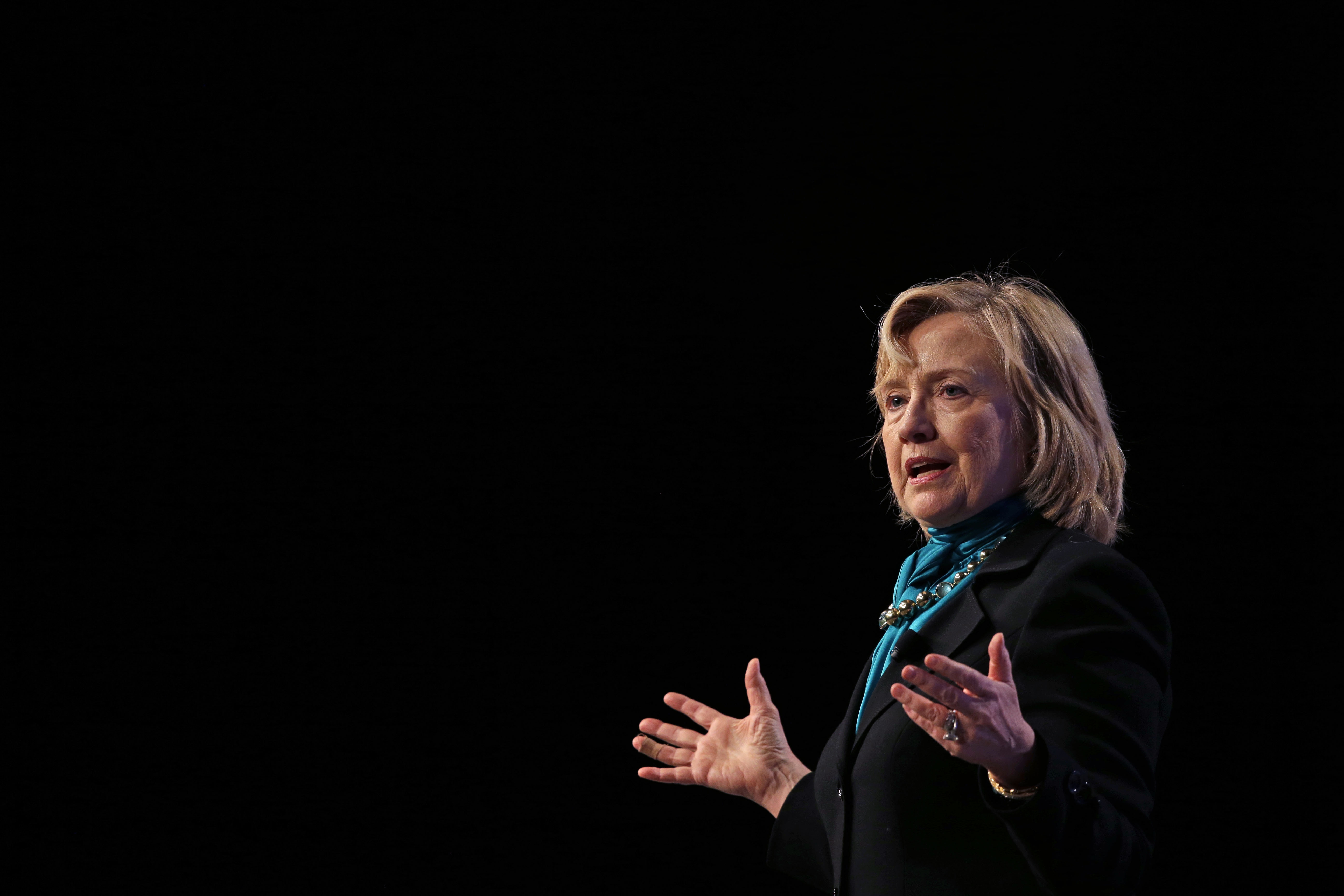 Former Secretary of State Hillary Rodham Clinton delivers remarks to the National Automobile Dealers Association meeting in New Orleans, Monday, Jan. 27, 2014