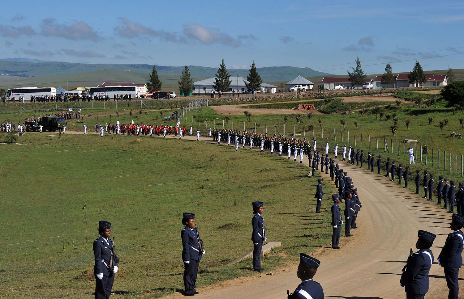 A military honor guard lines the route for former South African president Nelson Madela's funeral procession as it makes its way to his final resting place in his home village of Qunu on Dec. 15, 2013.