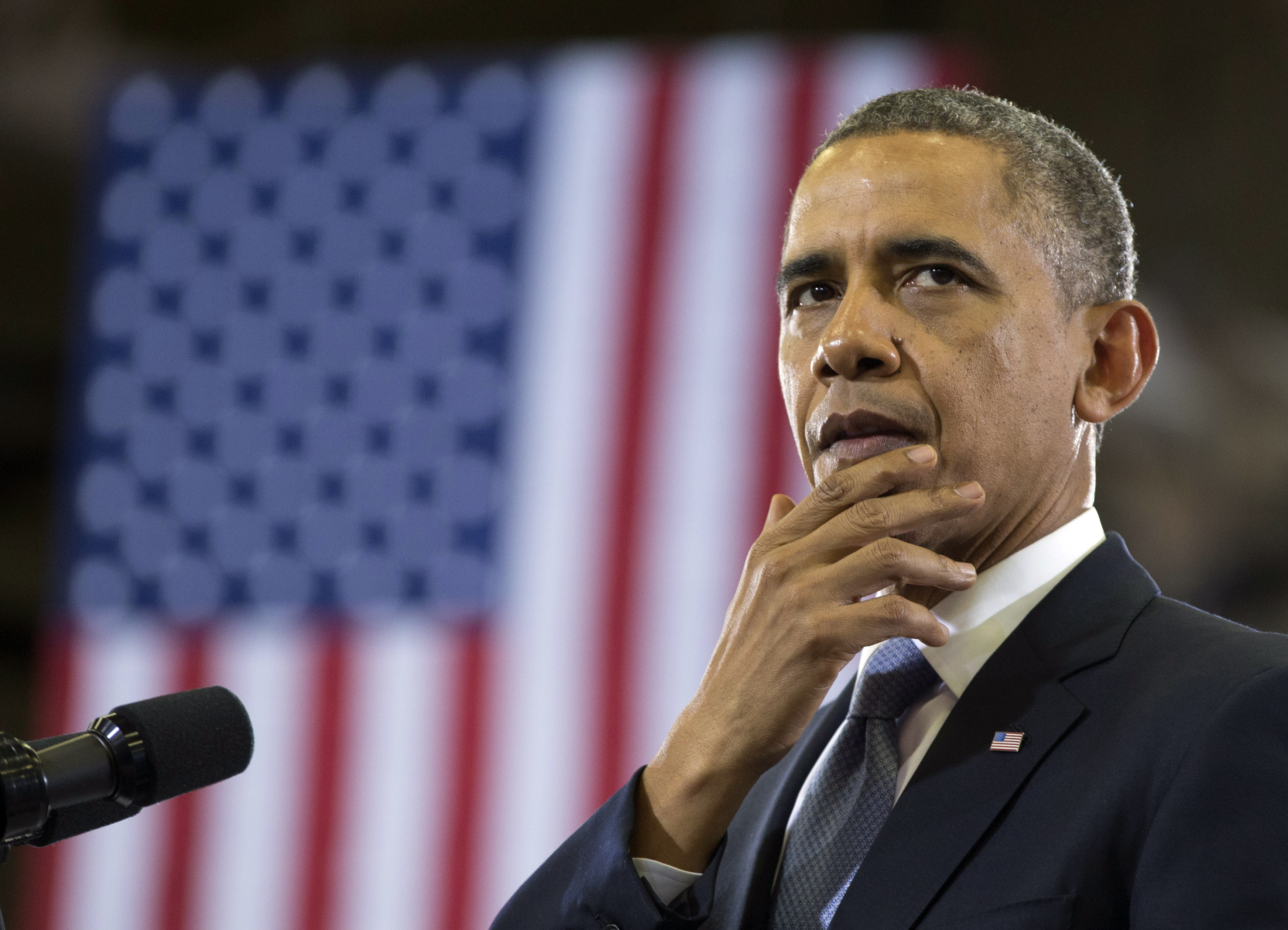 President Obama pauses as he speaks at McGavock High School, Jan. 30, 2014, in Nashville, Tenn., about education.