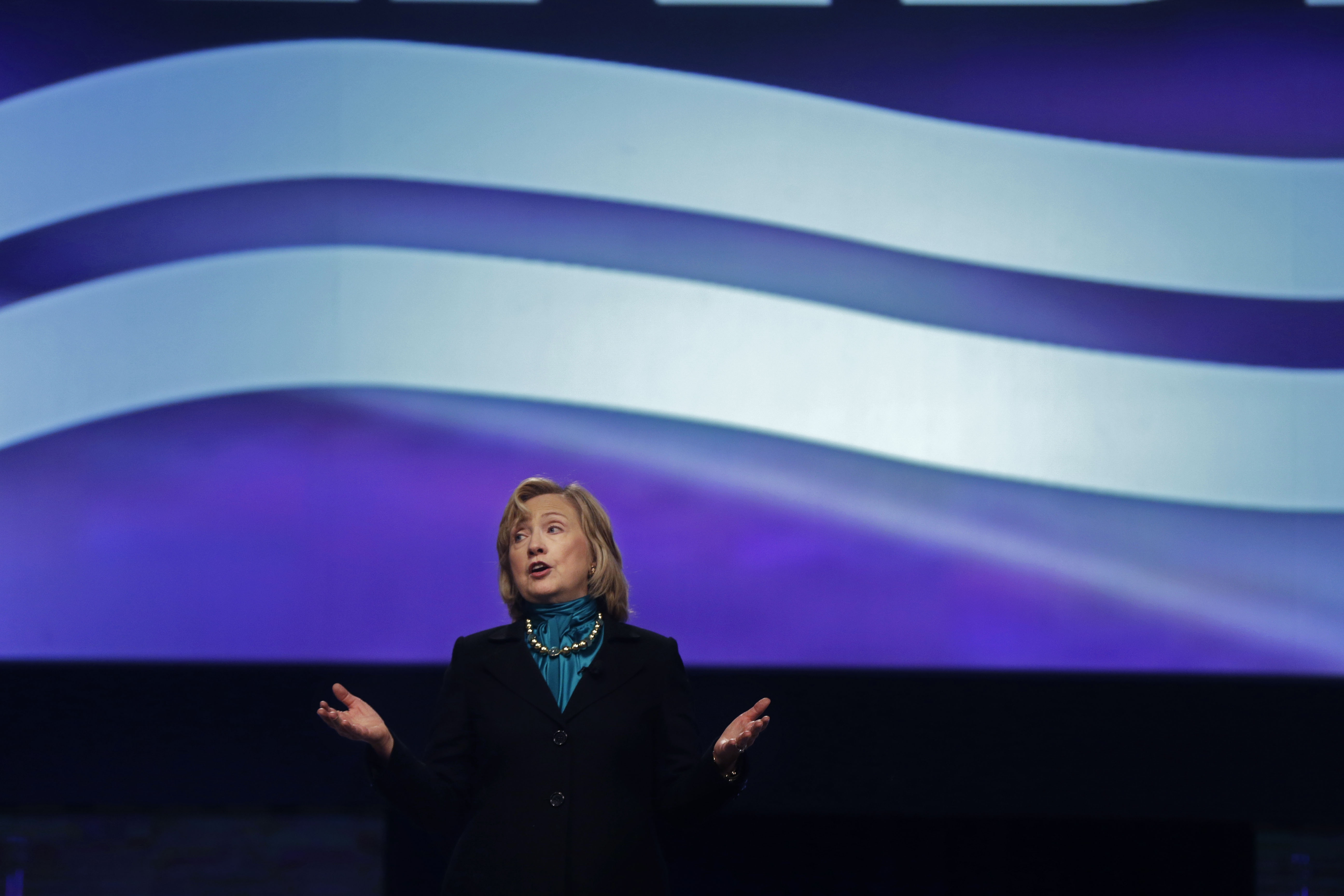 Former Secretary of State Hillary Rodham Clinton delivers remarks to the National Automobile Dealers Association meeting in New Orleans, Monday, Jan. 27, 2014.