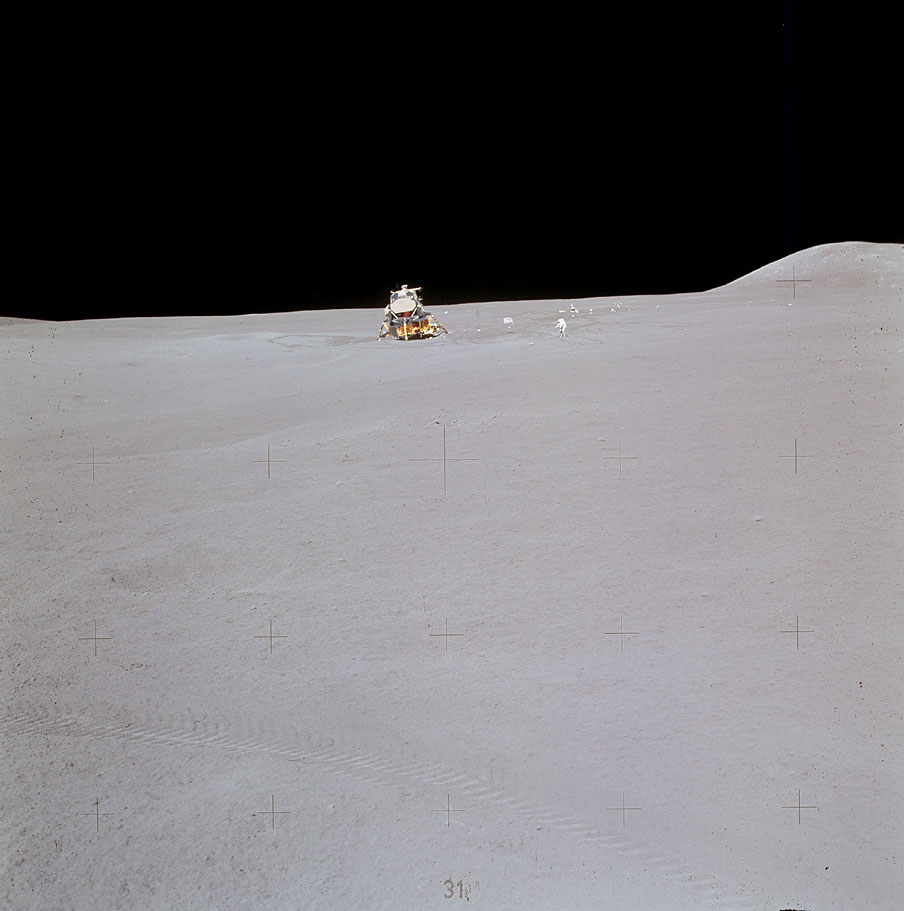 Jim Irwin with the lunar module and the ALSEP in the background. The distance the crew traveled from the EM home was considerable—and would have been forbidding if the rover had stalled.