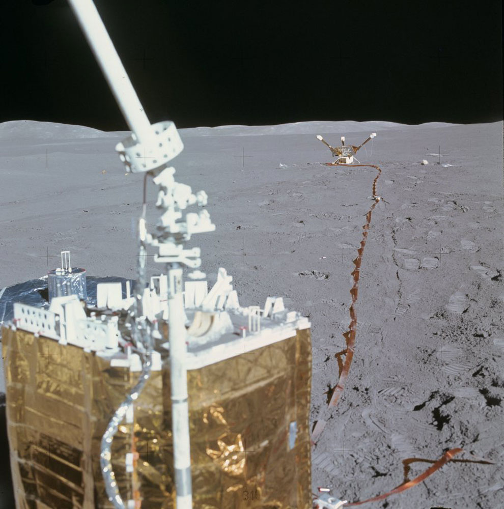 A single frame from a panning shot captures the central station, the lunar seismometer off to its left and the magnetometer in the background.