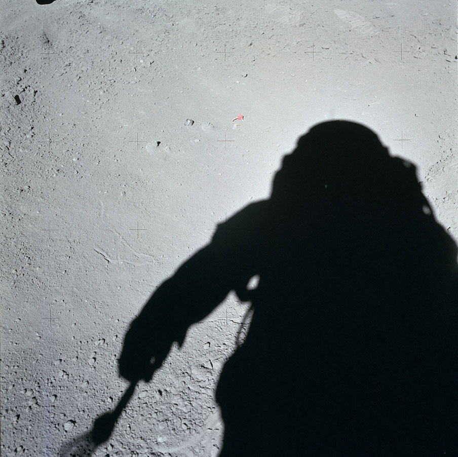 Among the most dramatic finds on Apollo 15 were deposits of tiny glass spheres in the soil—mostly green—that were the remains of fiery meteorite impacts. This shadowy shot of Scott was taken just before he and Jim Irwin collected the first samples.