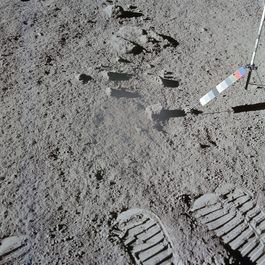 Lunar astronauts often took two pictures of the same sample spot to allow a stereoscopic perspective when the pictures were later developed. This is the second of a pair Dave Scott took after he scooped up soil at one site. The multi-colored strip on he right was used as a color reference.