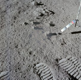 Lunar astronauts often took two pictures of the same sample spot to allow a stereoscopic perspective when the pictures were later developed. This is the second of a pair Scott took after he scooped up soil at one site. The multi-colored strip on he right was used as a color reference.