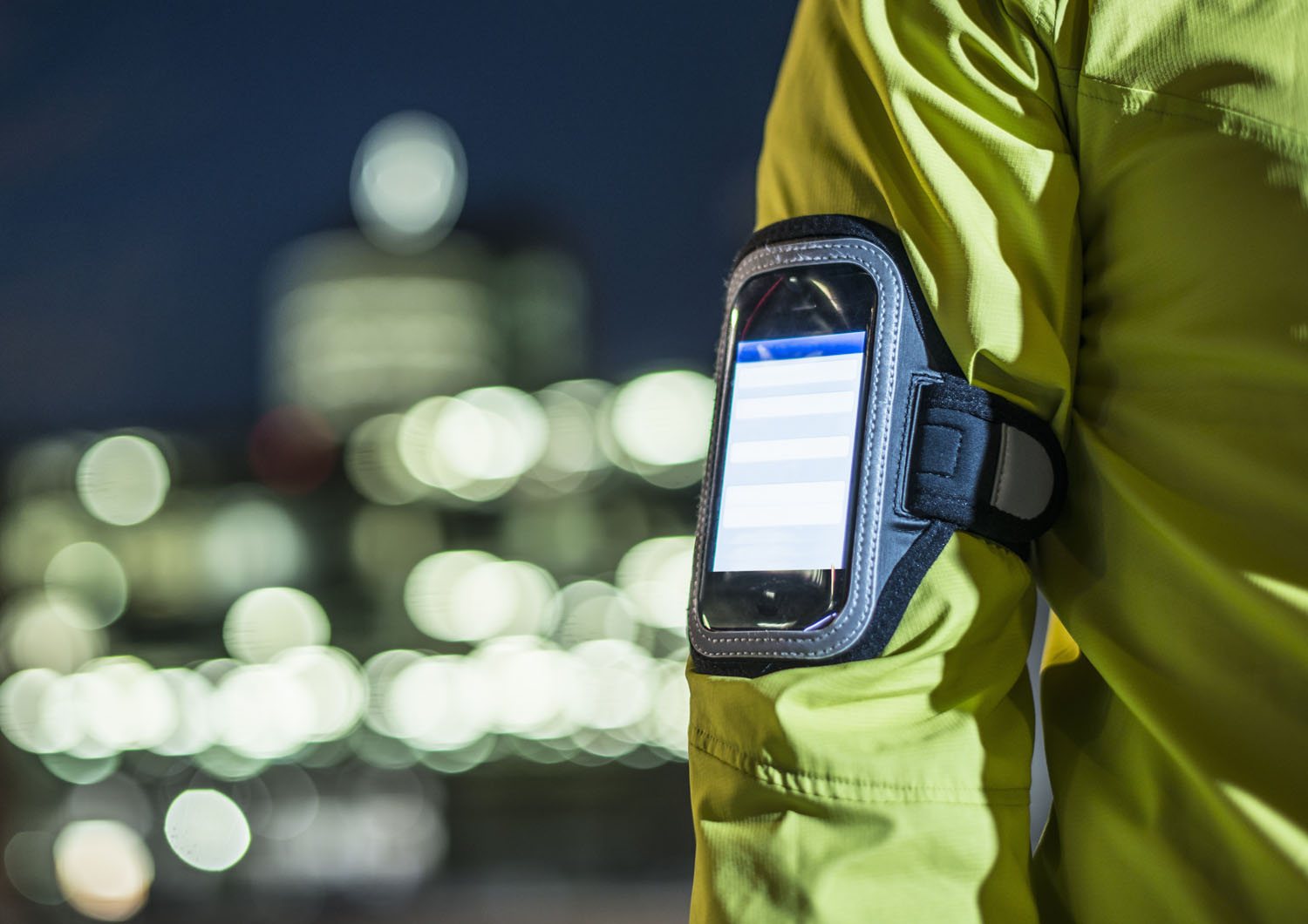A runner wears a smartphone on his arm.